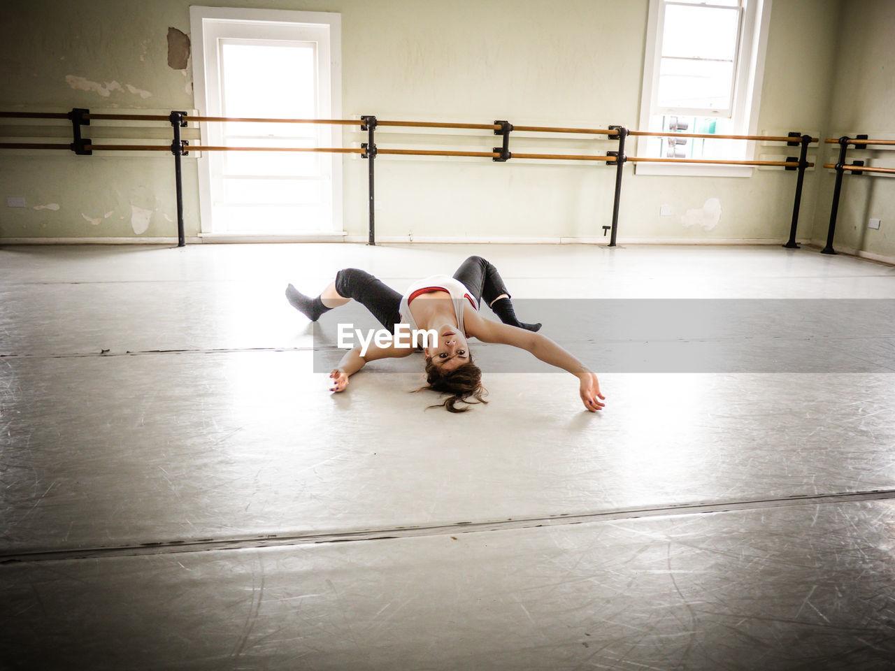 Full Length Ballet Dancer Practicing In
