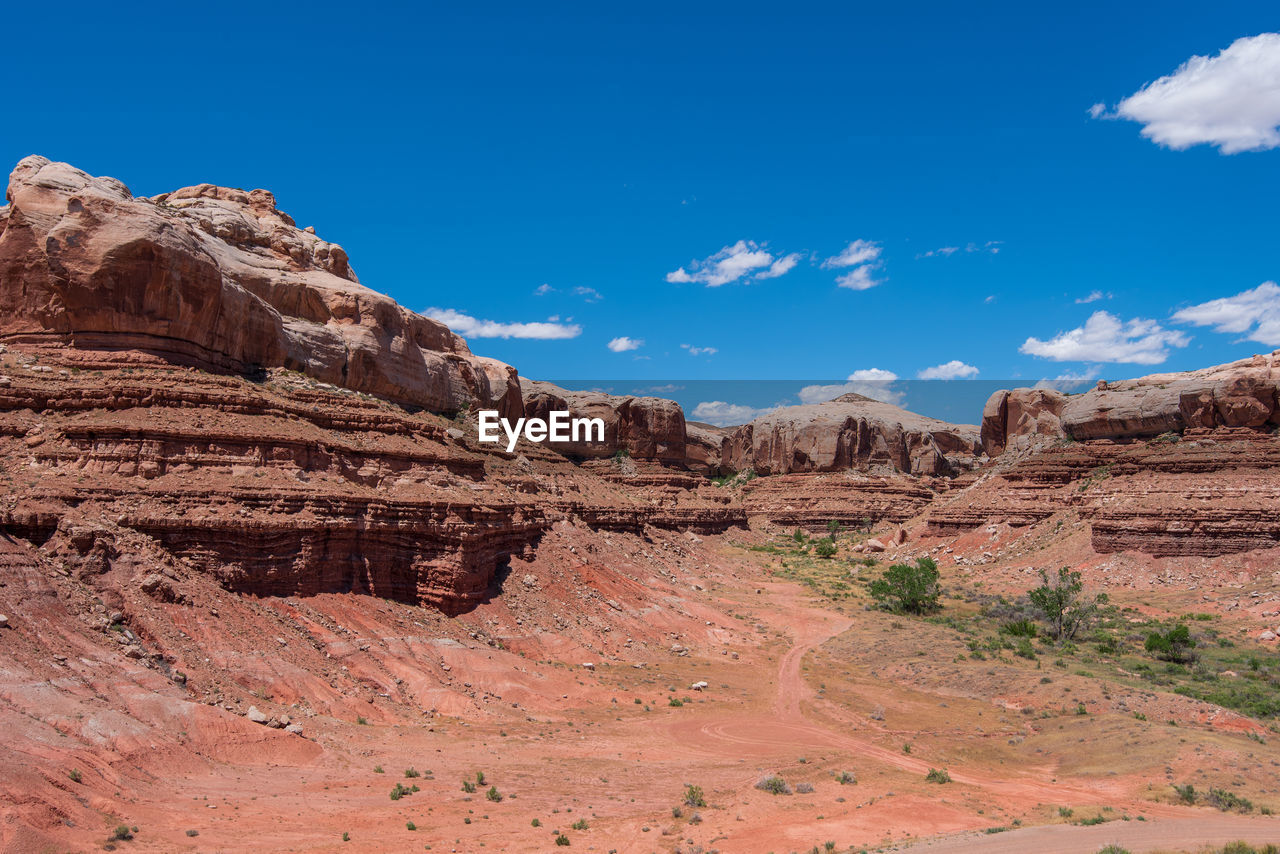 sky, rock formation, rock, geology, rock - object, scenics - nature, physical geography, tranquil scene, non-urban scene, mountain, solid, nature, tranquility, beauty in nature, landscape, travel destinations, environment, travel, cloud - sky, day, no people, eroded, arid climate, climate, mountain range, outdoors, formation, sandstone