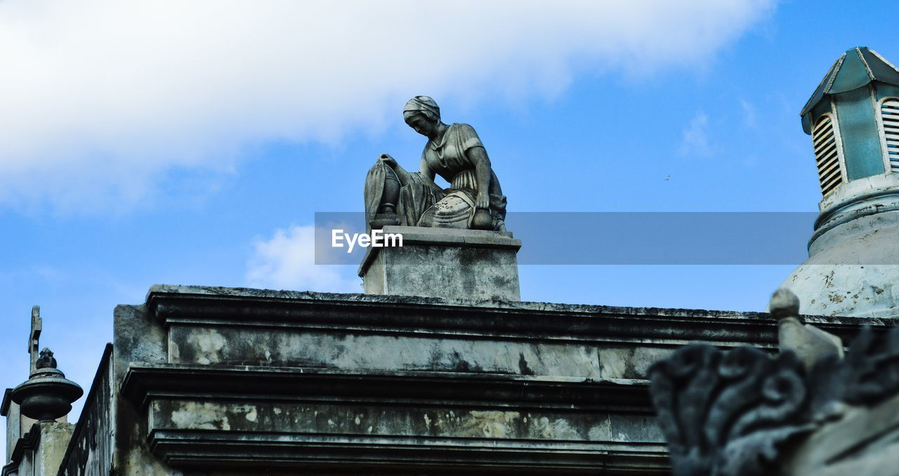 statue, sculpture, low angle view, architecture, human representation, built structure, male likeness, art and craft, outdoors, building exterior, sky, history, cloud - sky, no people, day