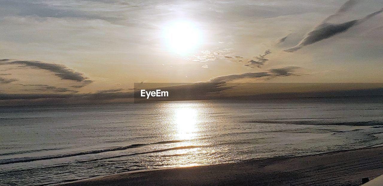 sky, sea, water, sunset, beauty in nature, scenics - nature, sunlight, beach, sun, land, tranquility, cloud - sky, tranquil scene, reflection, nature, horizon over water, sunbeam, horizon, idyllic, no people, lens flare, outdoors