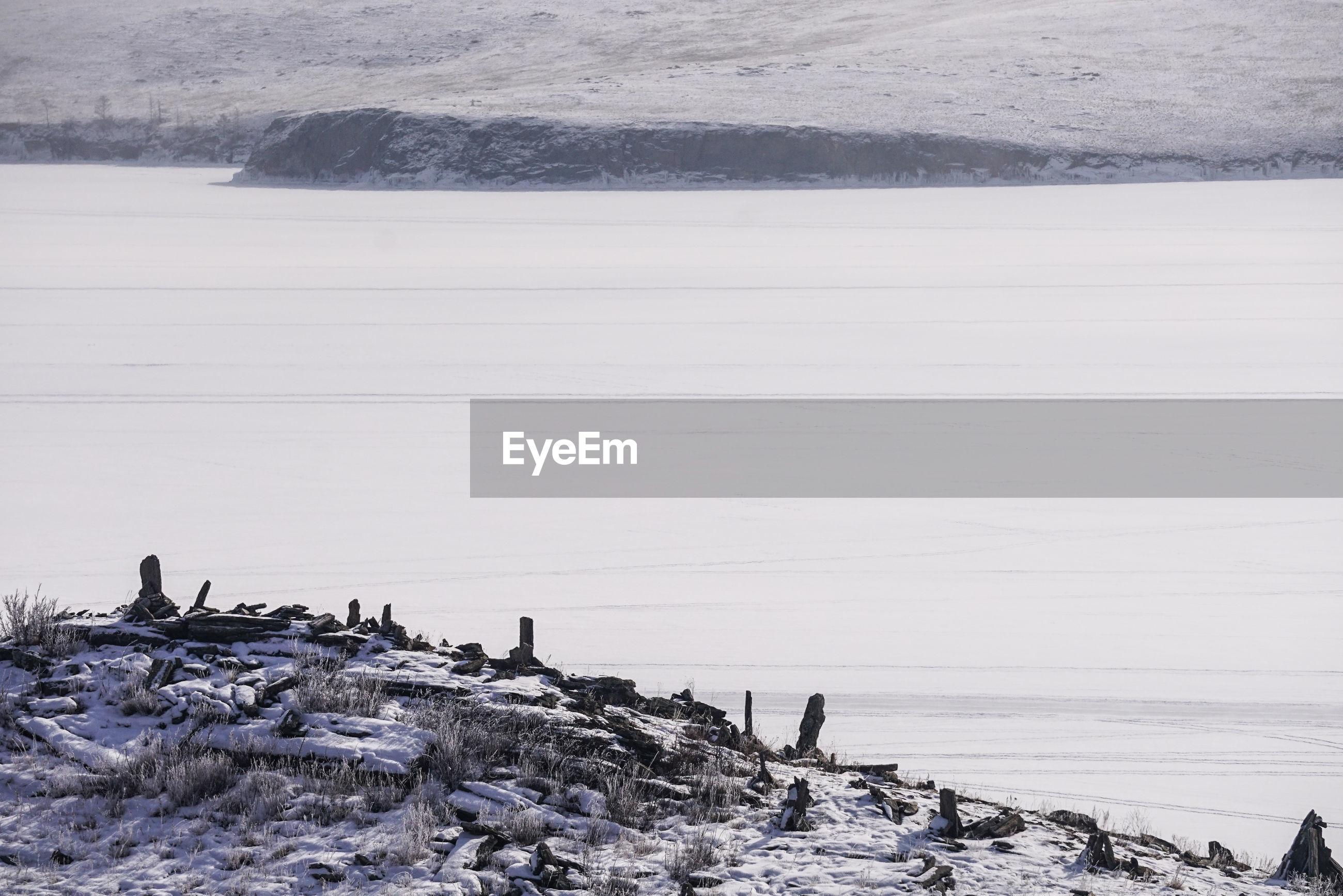 Landscape by frozen lake