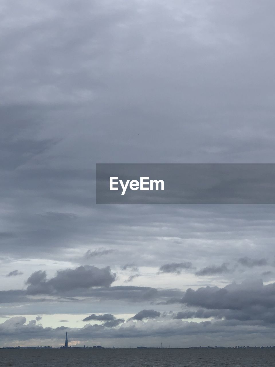 cloud - sky, sky, beauty in nature, scenics - nature, tranquility, tranquil scene, no people, nature, storm, overcast, outdoors, storm cloud, day, low angle view, cloudscape, environment, idyllic, thunderstorm, dramatic sky, ominous, meteorology