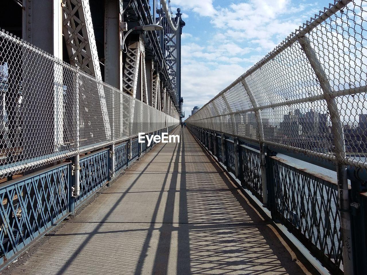 the way forward, cloud - sky, bridge - man made structure, railing, connection, architecture, built structure, sky, footbridge, day, outdoors, suspension bridge, no people, city