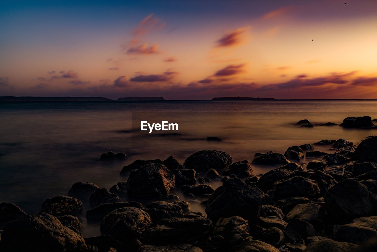 sunset, sky, sea, water, scenics - nature, beauty in nature, rock, solid, rock - object, tranquil scene, tranquility, cloud - sky, beach, land, no people, nature, idyllic, horizon over water, orange color, outdoors, rocky coastline