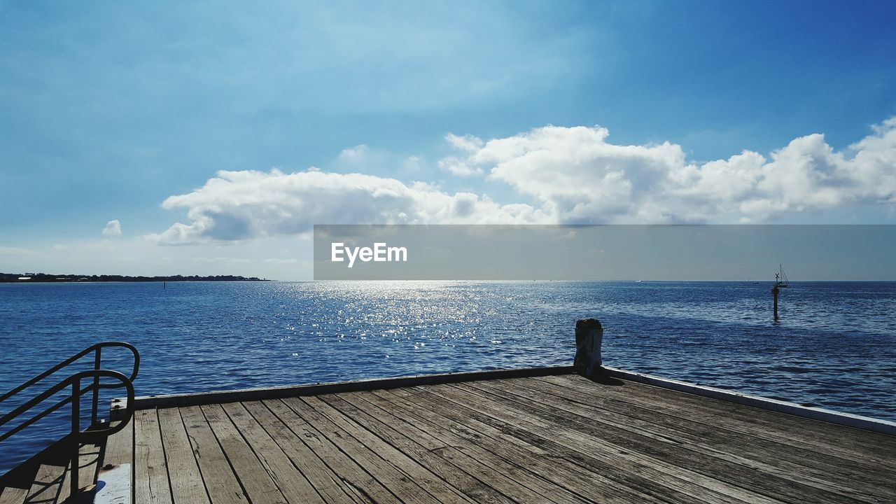 water, sea, sky, cloud - sky, scenics, nature, beauty in nature, tranquil scene, pier, horizon over water, idyllic, tranquility, railing, wood - material, day, outdoors, no people, jetty, wood paneling