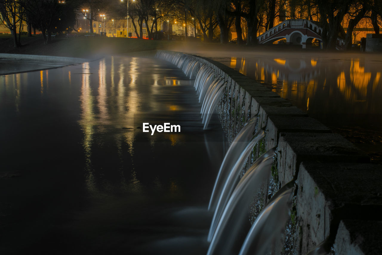 water, architecture, built structure, reflection, nature, no people, river, bridge, connection, transportation, bridge - man made structure, night, illuminated, long exposure, tree, waterfront, sunset, outdoors, arch bridge, flowing water