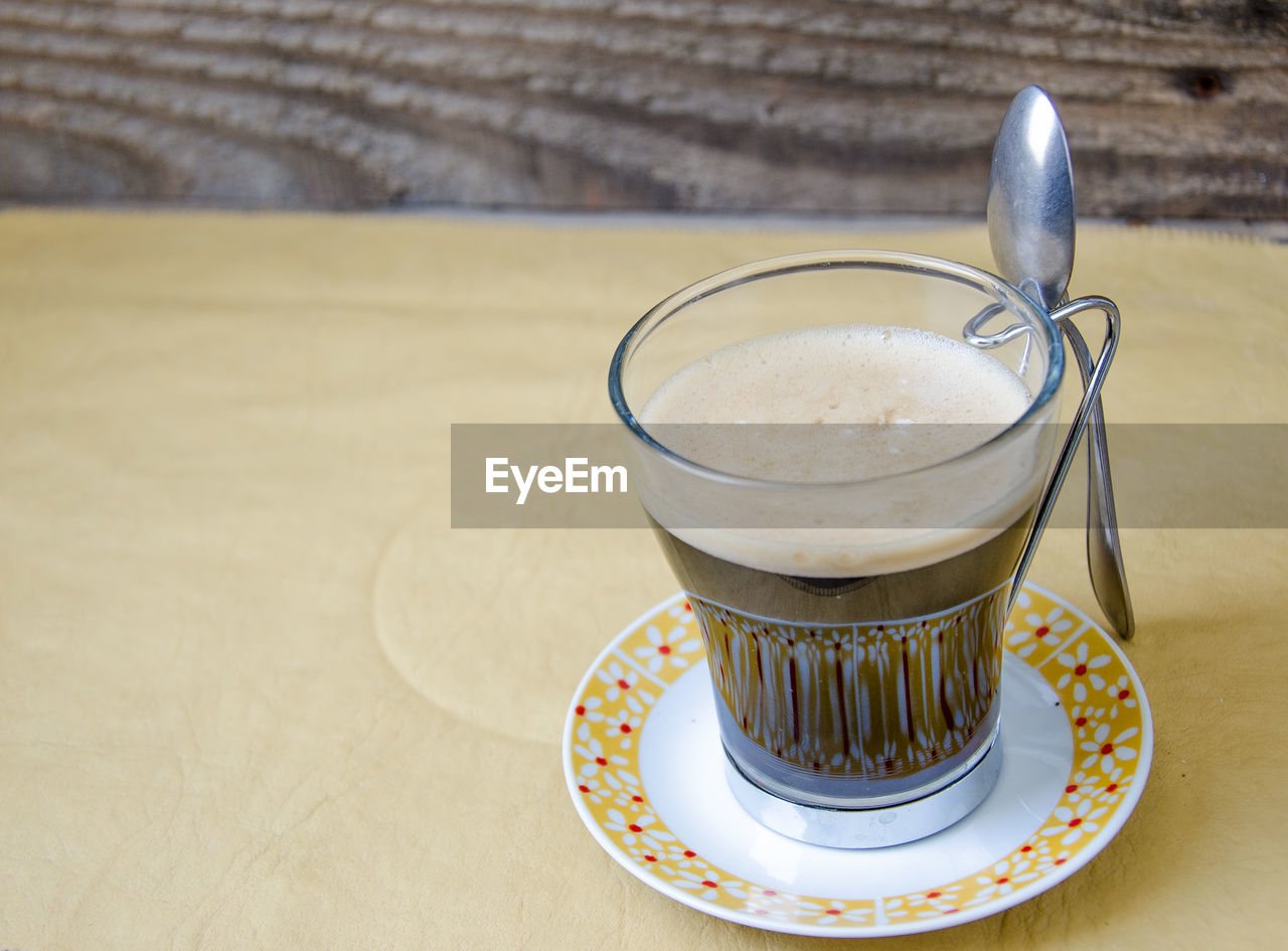 food and drink, eating utensil, table, kitchen utensil, spoon, drink, refreshment, food, still life, freshness, indoors, close-up, coffee, coffee - drink, focus on foreground, saucer, coffee cup, glass, no people, ready-to-eat, crockery, temptation, latte