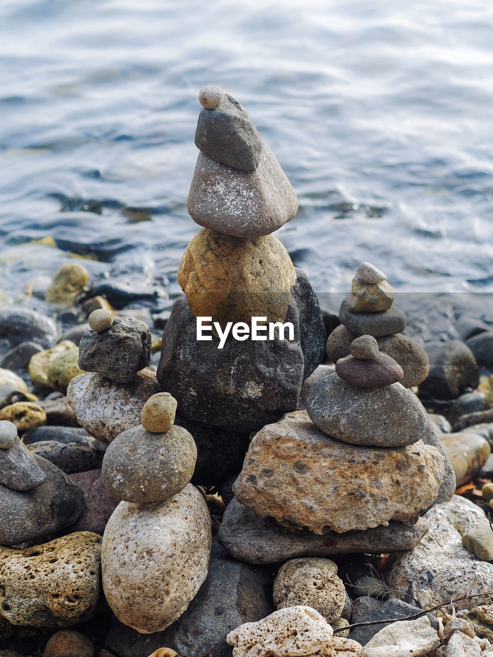 solid, rock, stone - object, water, balance, rock - object, zen-like, stack, no people, nature, pebble, sea, day, stone, beach, land, beauty in nature, tranquility, textured, outdoors, flowing water, marine
