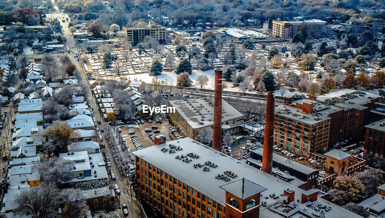 snow, architecture, cold temperature, winter, building exterior, high angle view, built structure, city, cityscape, outdoors, day, no people, travel destinations, nature