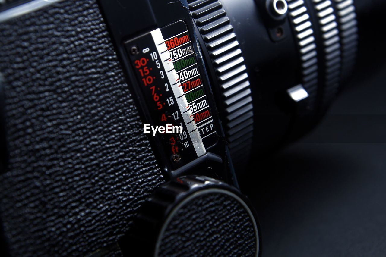 technology, close-up, indoors, transportation, number, vehicle interior, mode of transportation, land vehicle, car interior, control, black color, car, equipment, no people, focus on foreground, communication, selective focus, motor vehicle, accuracy, electrical equipment