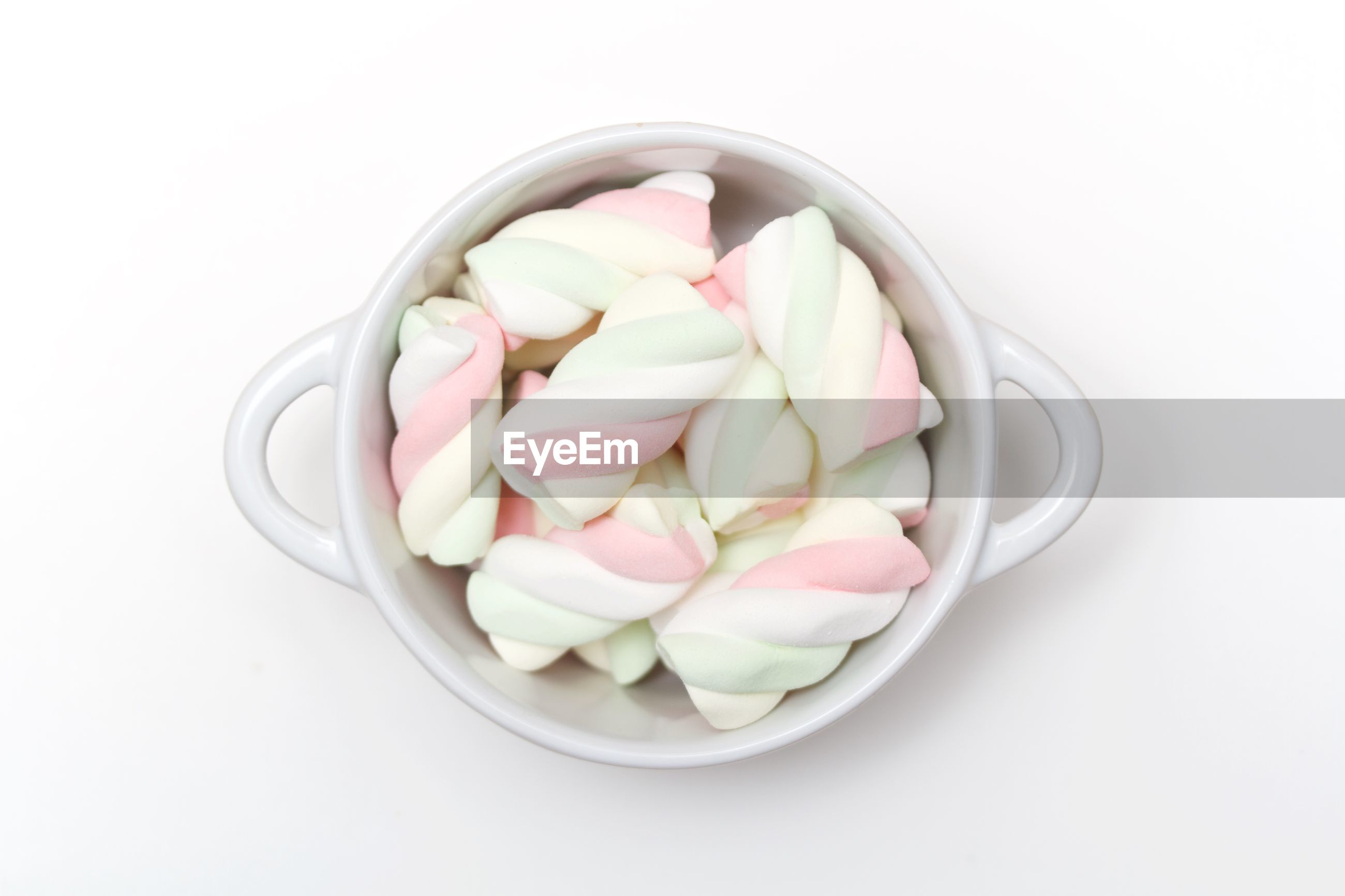 High angle view of marshmallow in bowl against white background