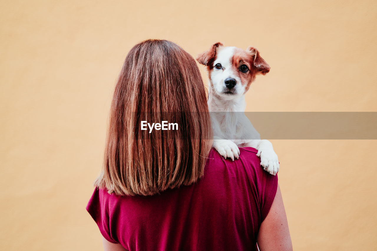 Rear view of woman with dog