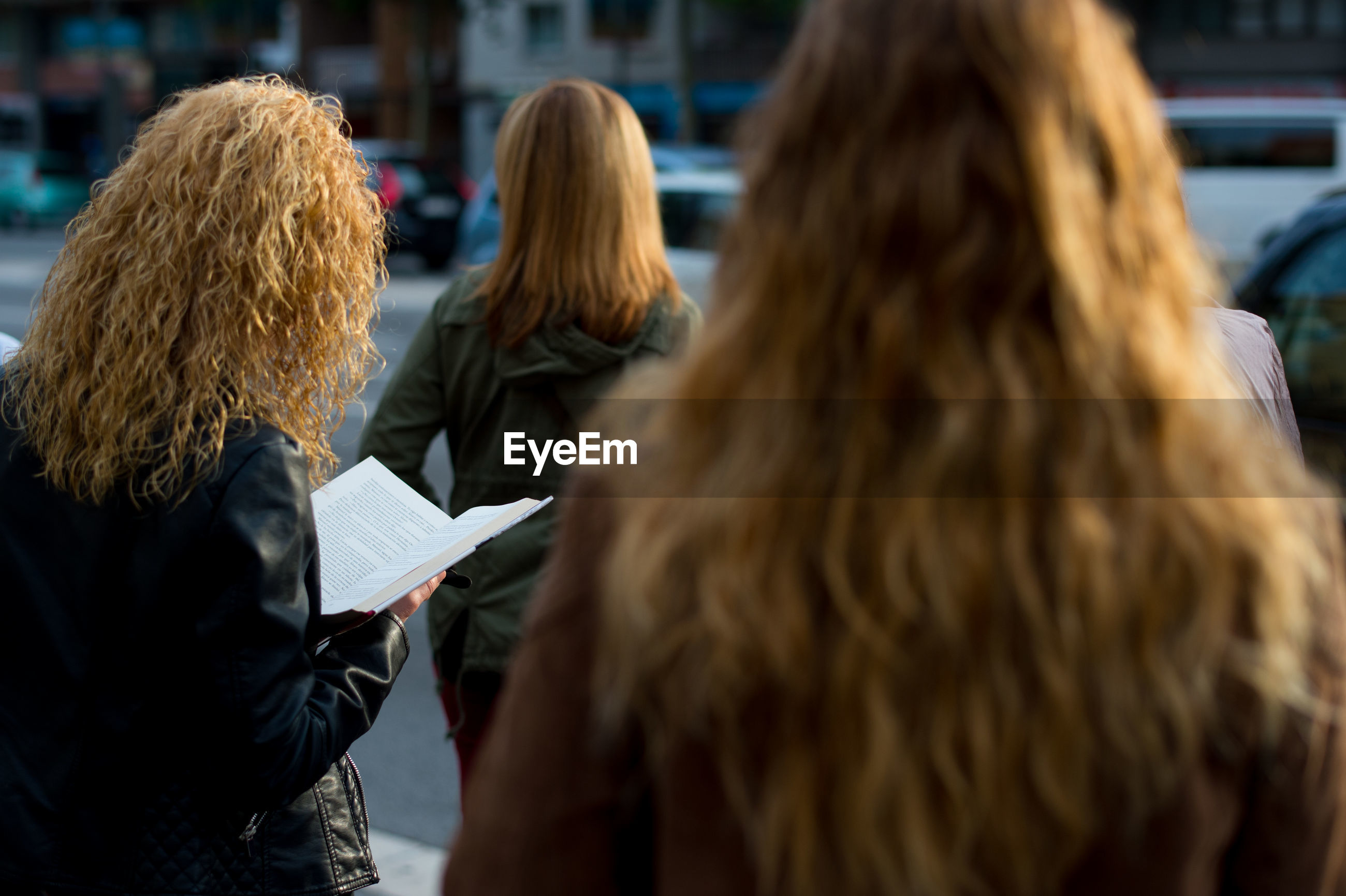 Rear view of women on street