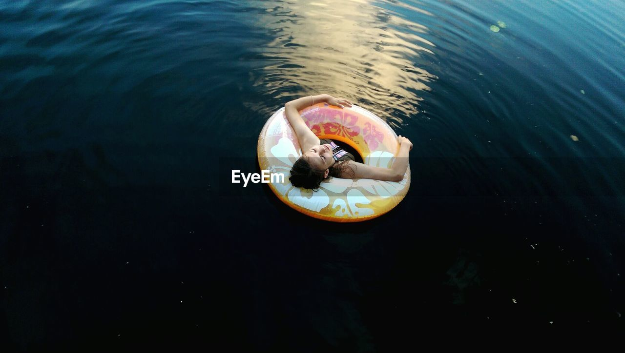 High Angle View Of Woman With Inflatable Ring In Lake