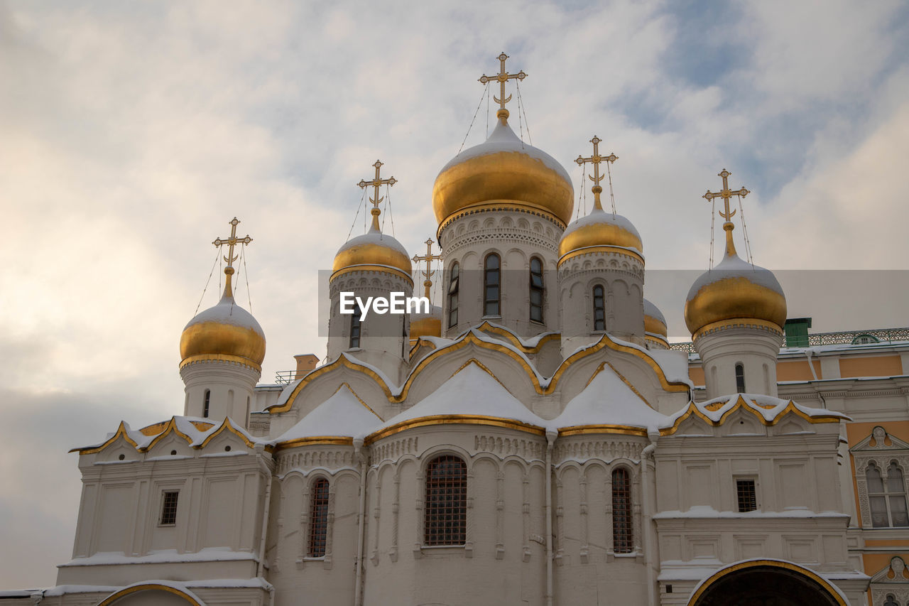 building exterior, place of worship, architecture, religion, belief, spirituality, built structure, building, sky, cloud - sky, low angle view, dome, no people, nature, cross, day, arch, outdoors, spire