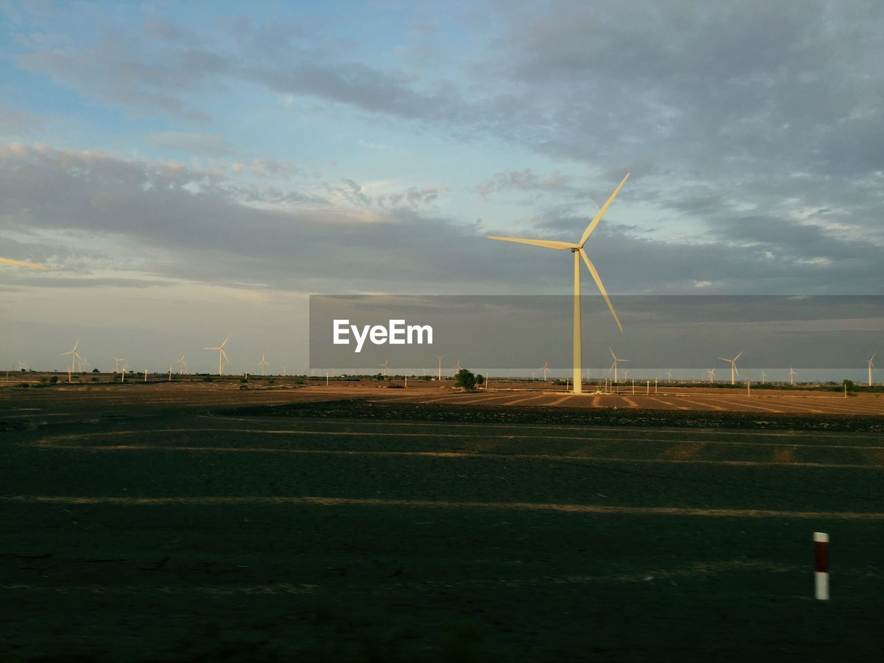 wind turbine, wind power, alternative energy, environmental conservation, renewable energy, windmill, fuel and power generation, industrial windmill, rural scene, field, sky, no people, technology, nature, day, outdoors, landscape, cloud - sky, traditional windmill, beauty in nature