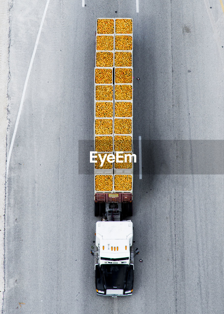 High angle view of truck with orange container on road