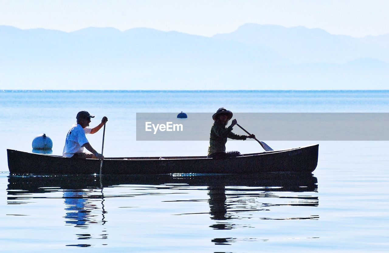 water, nautical vessel, real people, men, transportation, nature, scenics, beauty in nature, sea, waterfront, sky, outdoors, oar, day, people