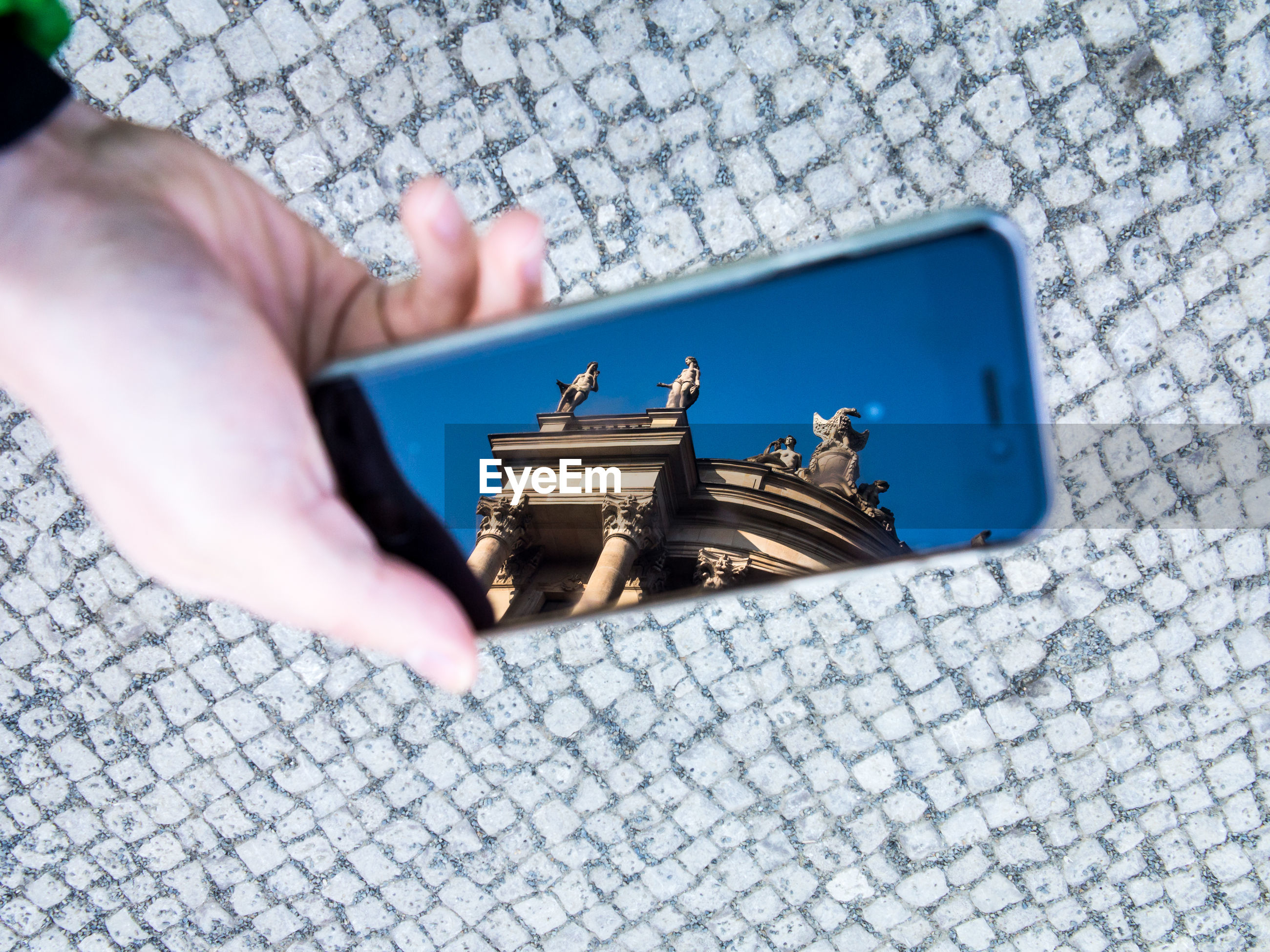 Reflection of berlin cathedral in smart phone