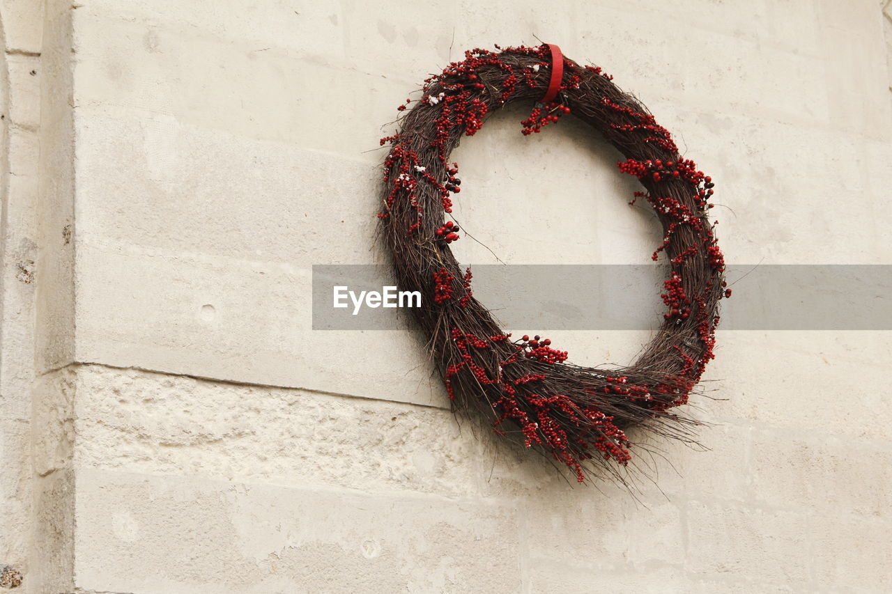 Low angle view of wreath on wall