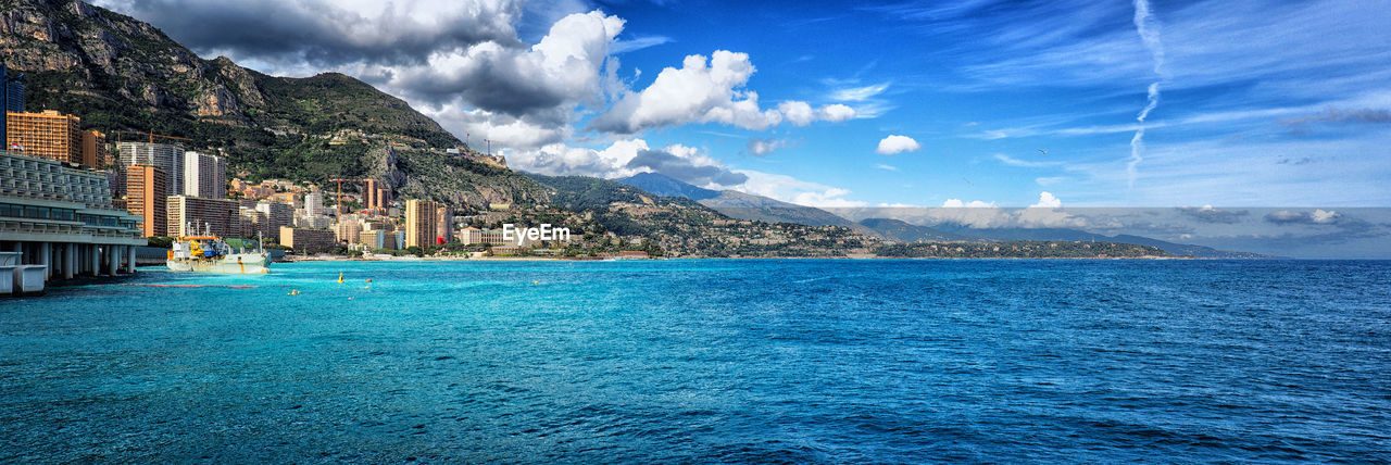 water, cloud - sky, sky, architecture, built structure, mountain, waterfront, sea, beauty in nature, scenics - nature, building exterior, building, nature, no people, tranquility, day, tranquil scene, idyllic, outdoors, turquoise colored