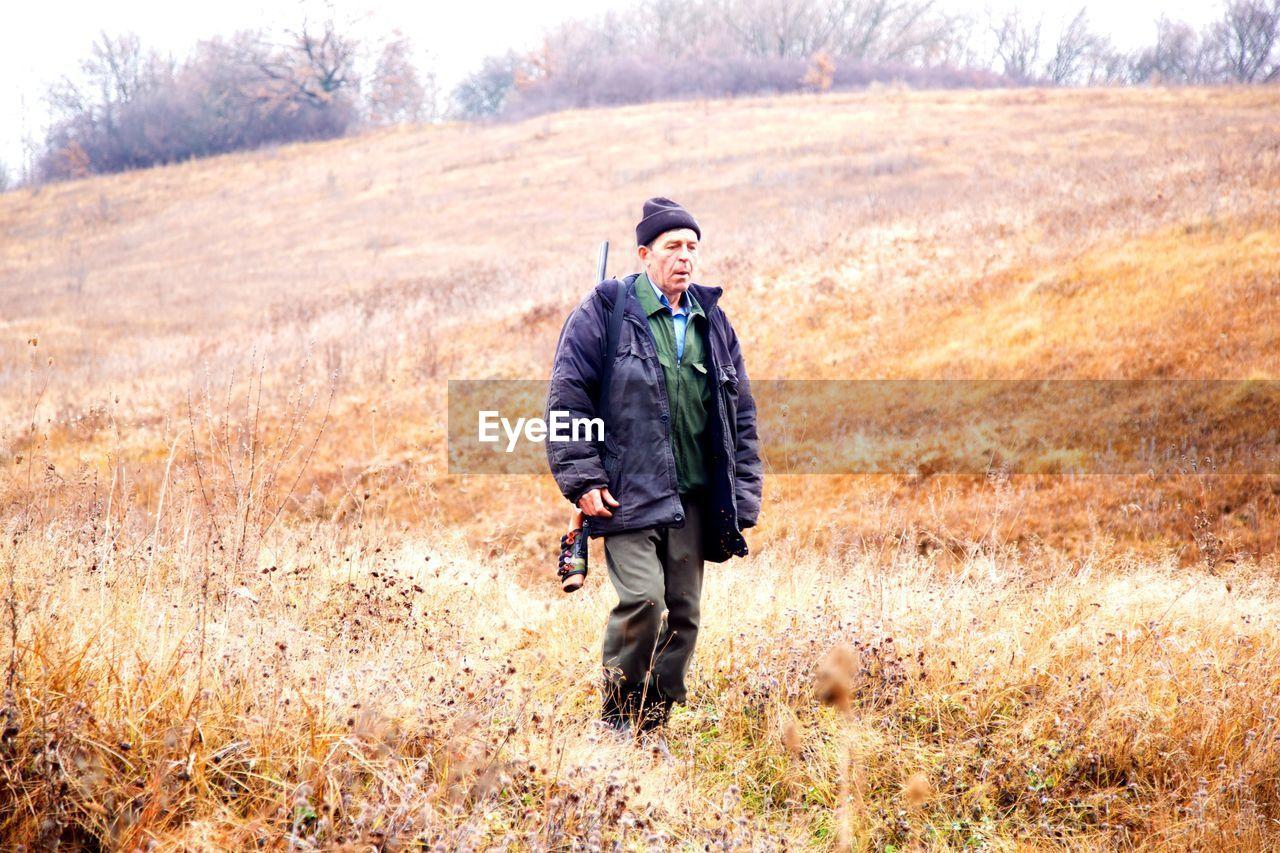 Full Length Of A Man Walking In Field