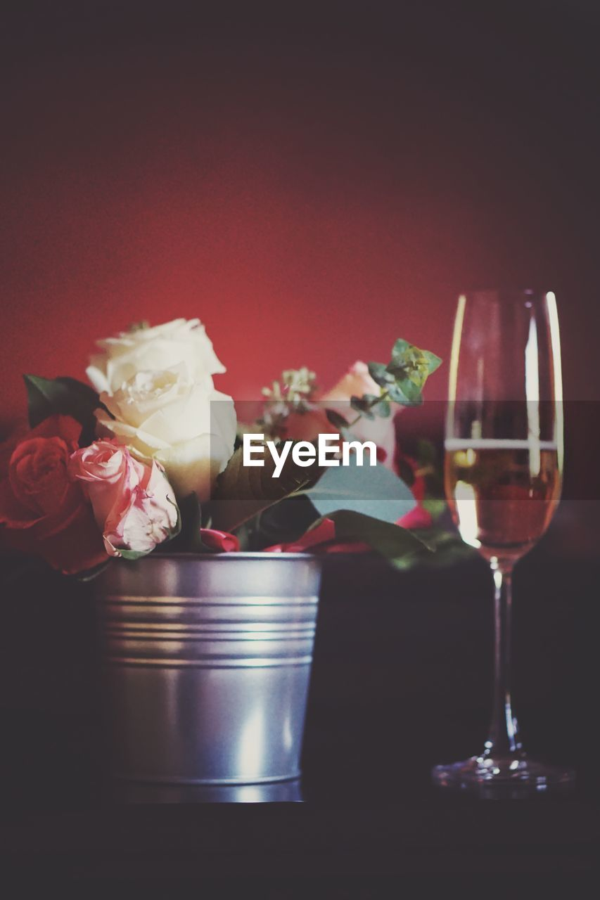 flower, rose - flower, indoors, celebration, no people, food and drink, table, wine, red, close-up, wineglass, alcohol, gift, freshness, food, bouquet, fragility, nature, flower head, day