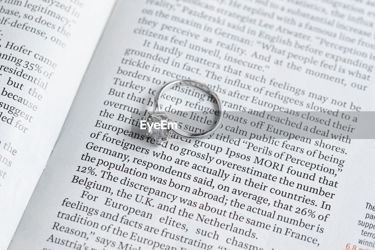 belief, wedding, religion, ring, spirituality, publication, text, book, love, event, celebration, close-up, paper, communication, jewelry, page, emotion, positive emotion