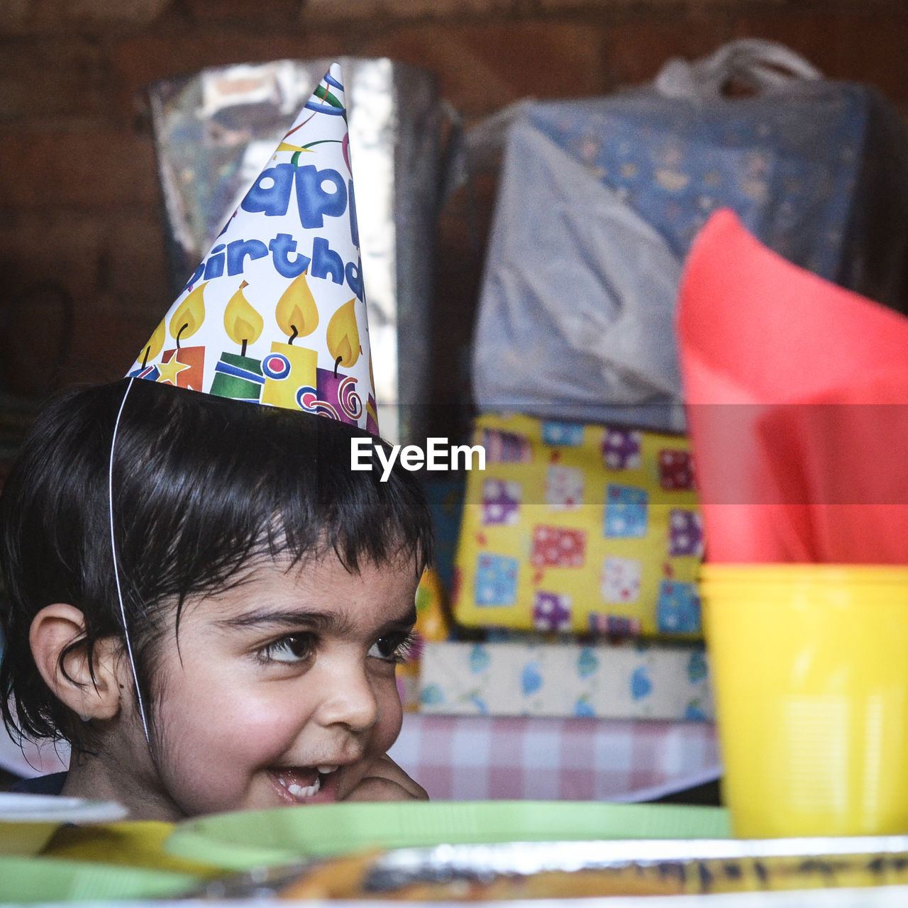 Close-up of boy wearing party hat at home