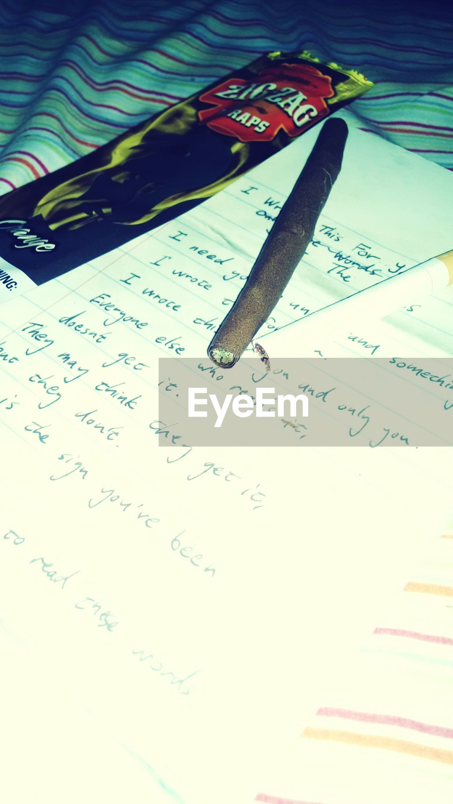 text, western script, indoors, communication, paper, close-up, still life, high angle view, table, book, education, pen, no people, number, art and craft, handwriting, pencil, single object, tilt, part of