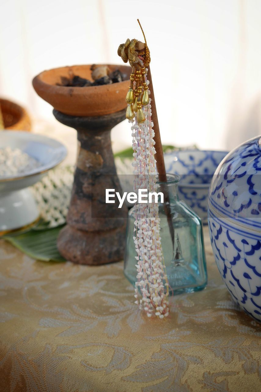 table, focus on foreground, indoors, still life, no people, close-up, food and drink, food, plate, freshness, design, high angle view, transparent, variation, choice, pattern, selective focus, glass - material, sweet food, indulgence, floral pattern, temptation
