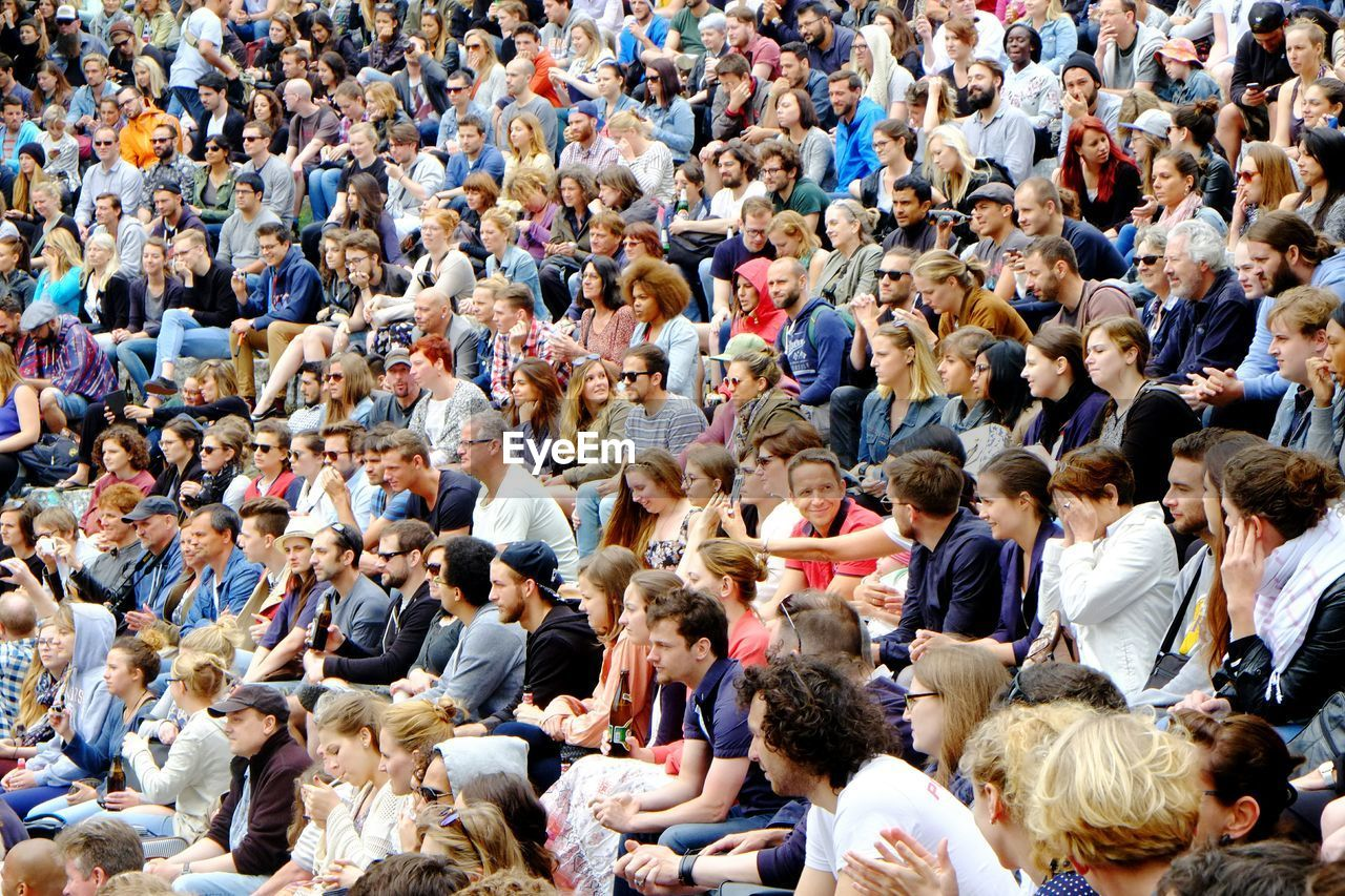 Crowded Audience Sitting In Stadium