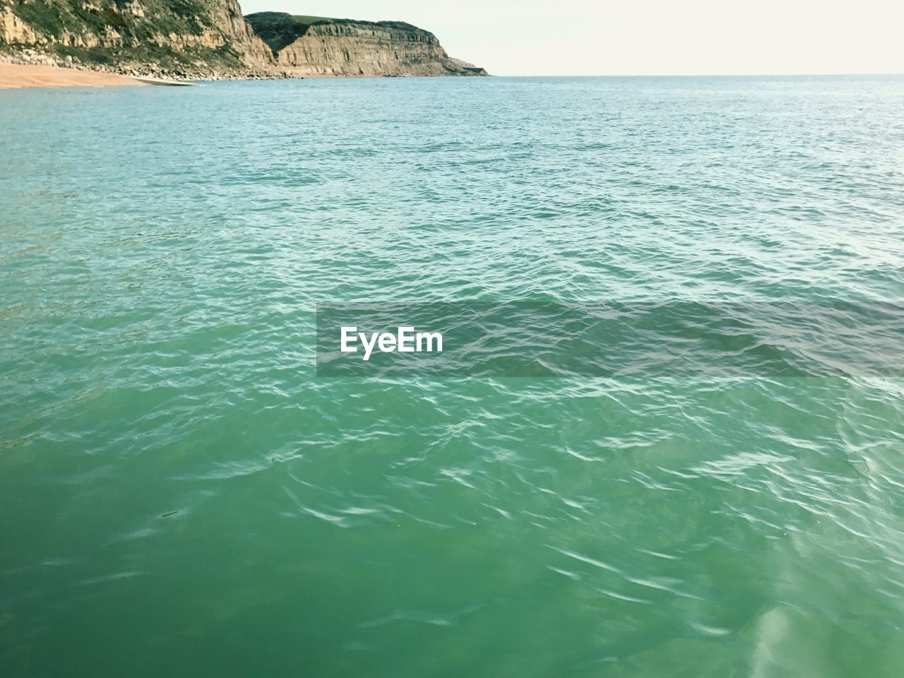sea, rippled, water, nature, tranquility, tranquil scene, beauty in nature, scenics, outdoors, day, no people, waterfront, clear sky, horizon over water, sky