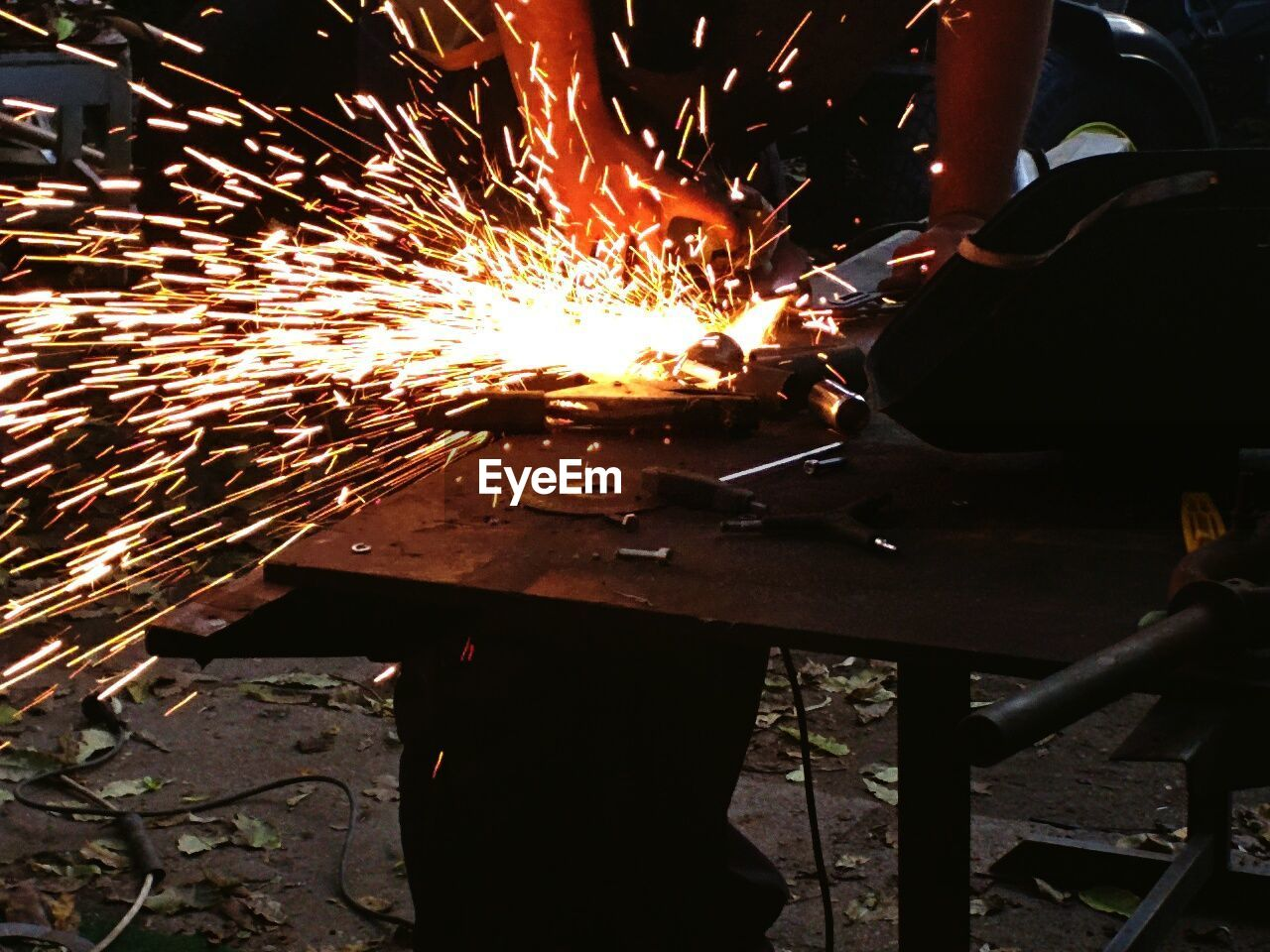 sparks, workshop, working, occupation, metal industry, glowing, heat - temperature, motion, industry, work tool, metal, skill, burning, men, manual worker, grinder, indoors, one person, expertise, flame, real people, welder, factory, people