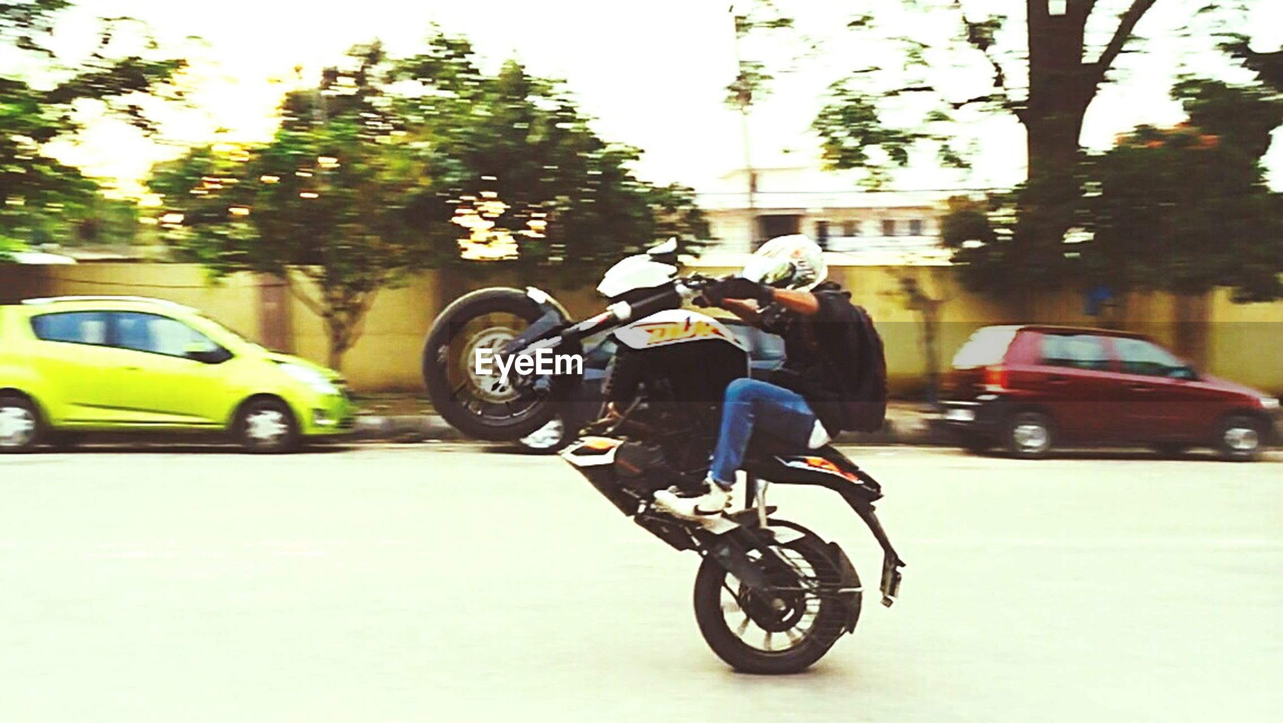 land vehicle, transportation, mode of transport, bicycle, car, stationary, street, parked, parking, motorcycle, riding, road, travel, tree, cycling, on the move, motor scooter, day, side view, vehicle