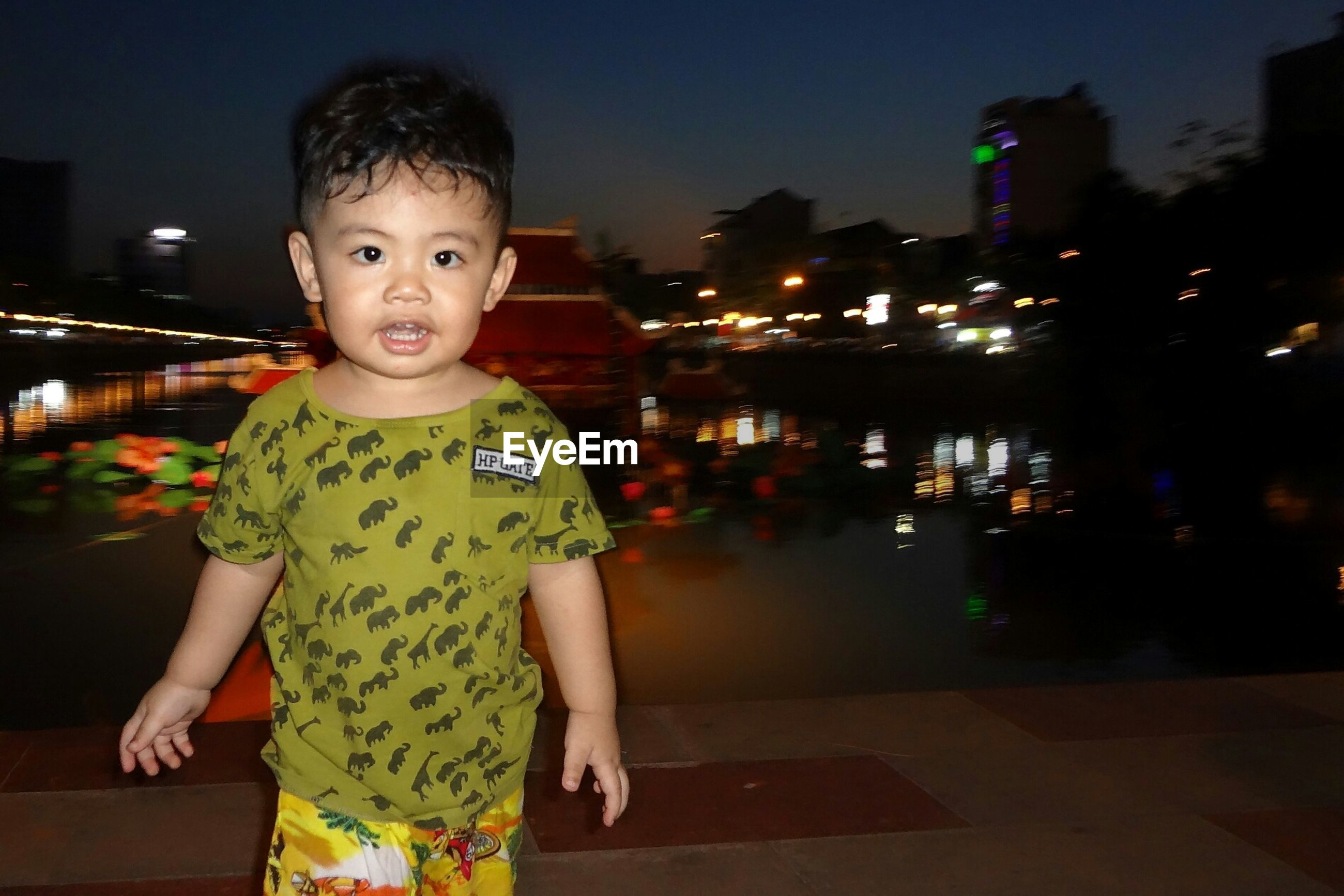Portrait of a boy smiling outdoors at night