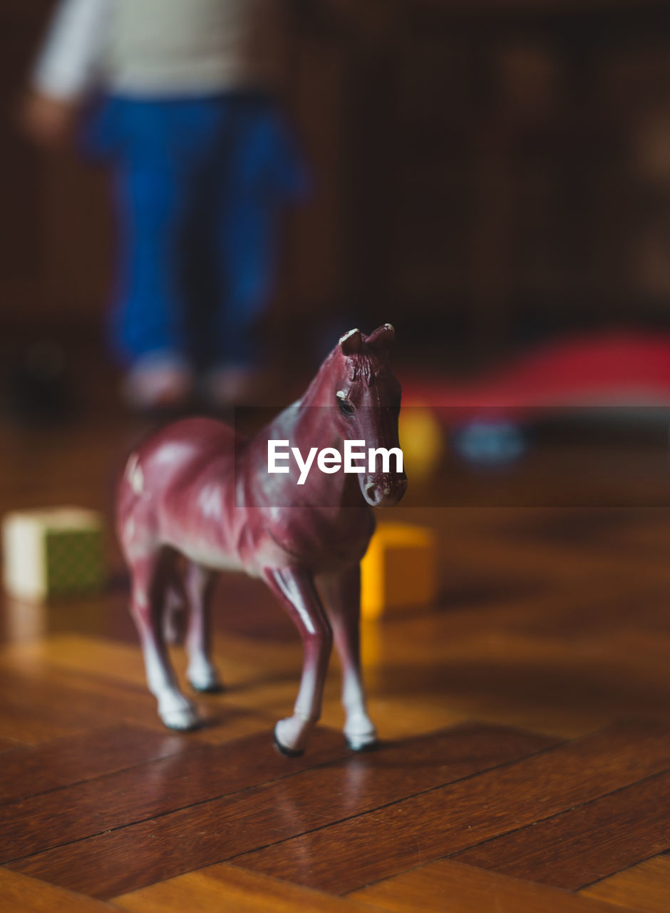 Close-Up Of Toy Horse On Floor At Home