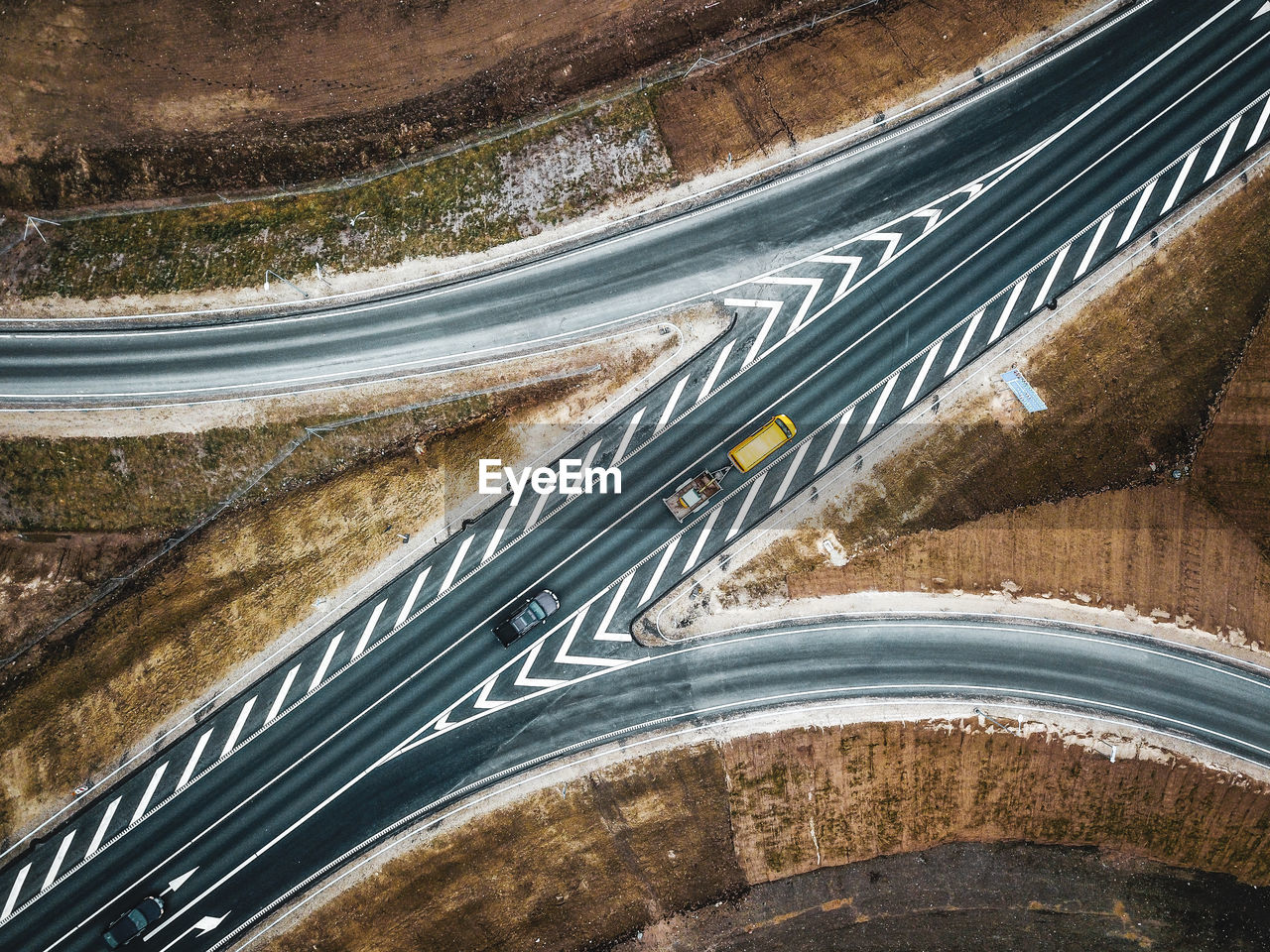 transportation, road, mode of transportation, high angle view, car, no people, land vehicle, motor vehicle, highway, motion, connection, city, street, day, on the move, sign, nature, road marking, symbol, multiple lane highway, outdoors