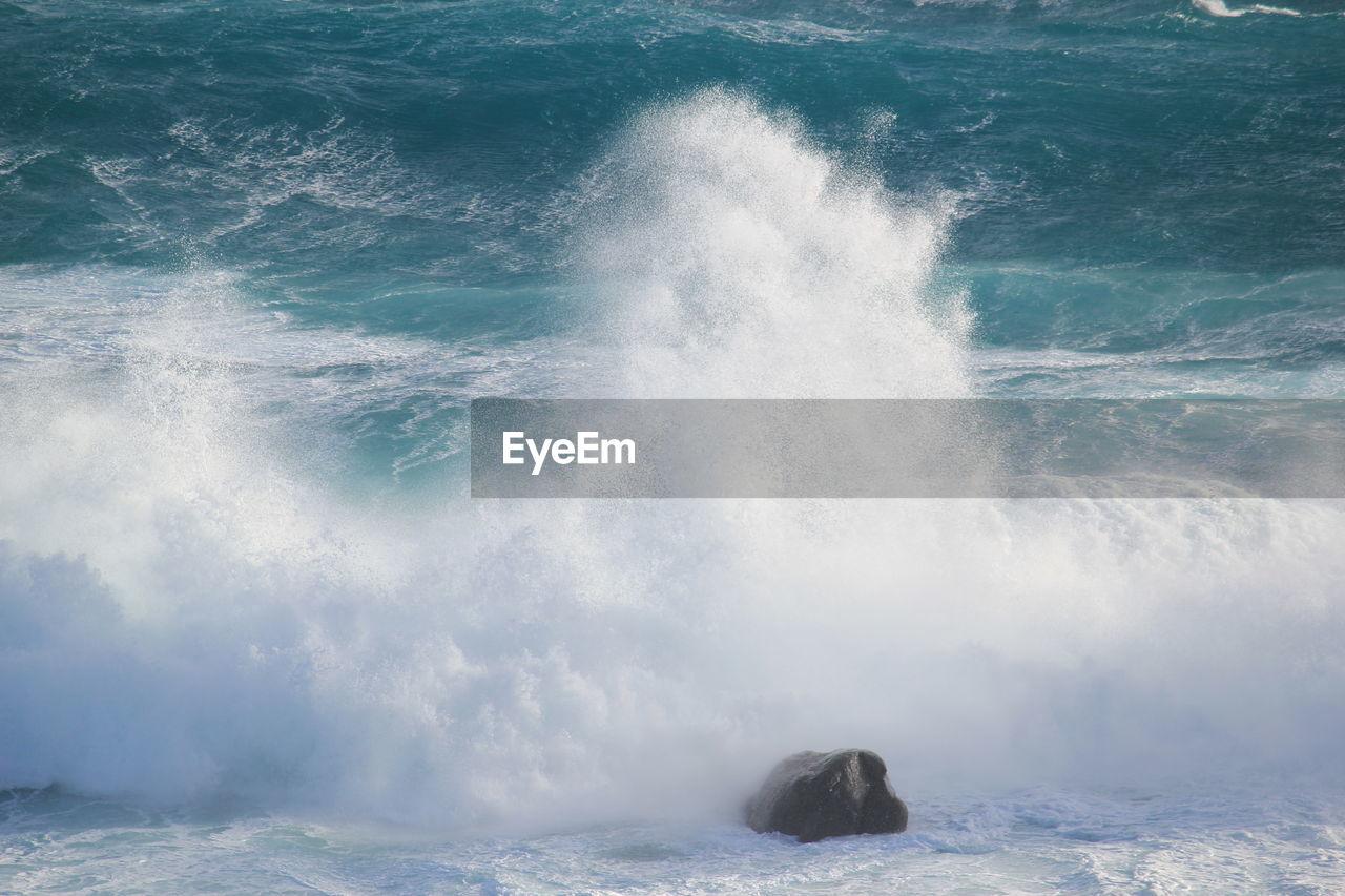 SCENIC VIEW OF SEA WAVES SPLASHING