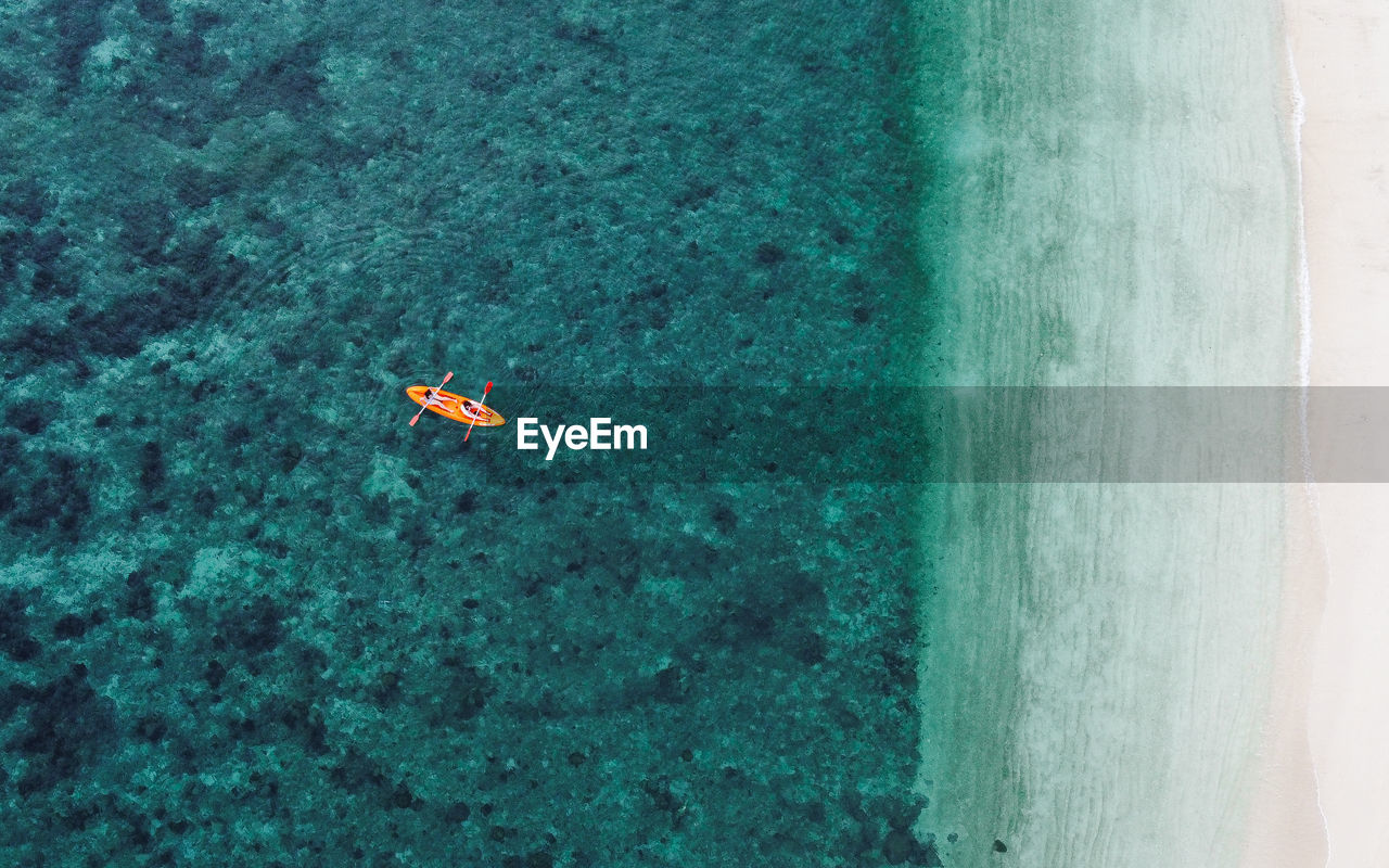 High angle view of kayaking in sea