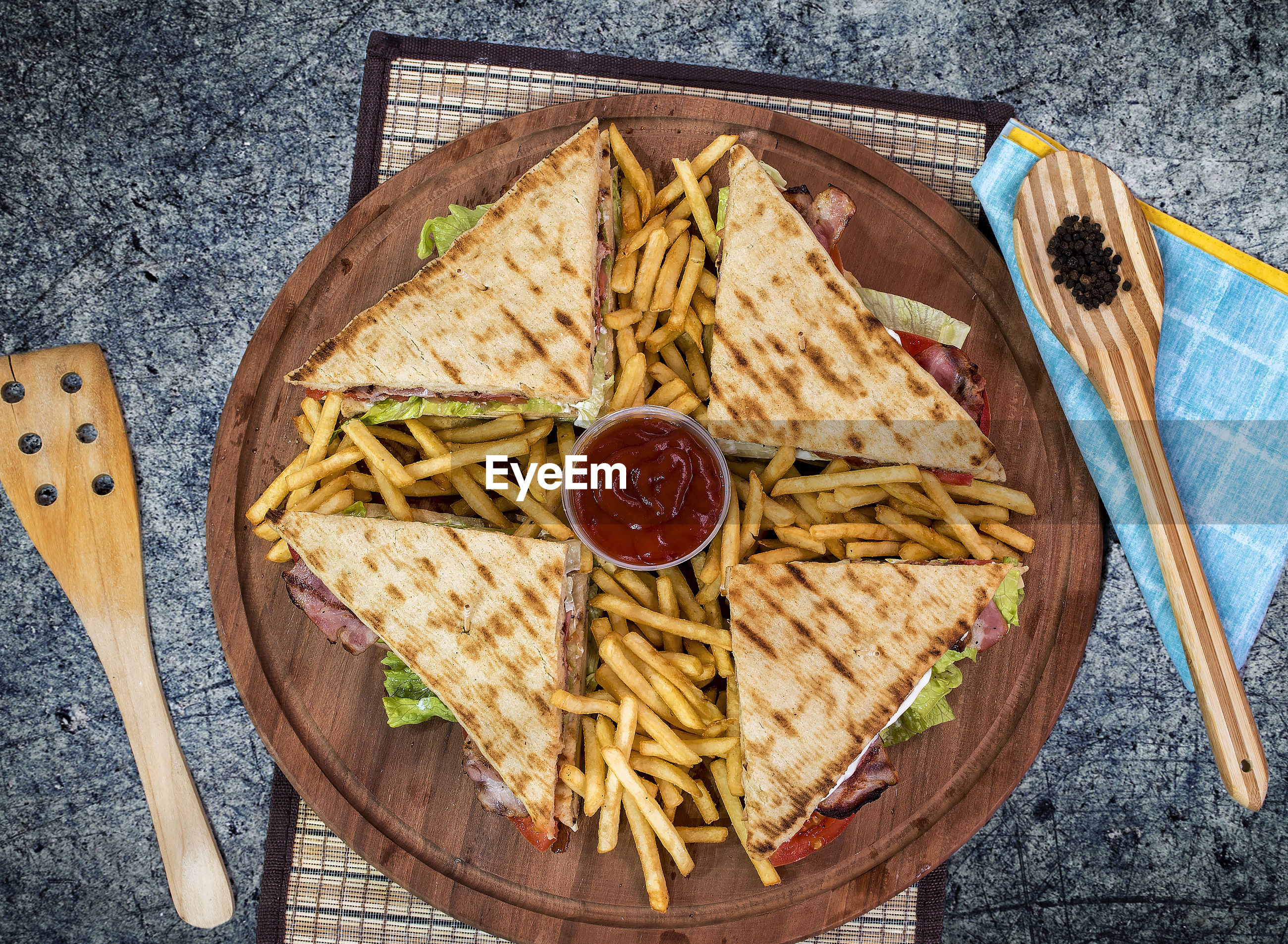 High angle view of sandwiches with french fries on table