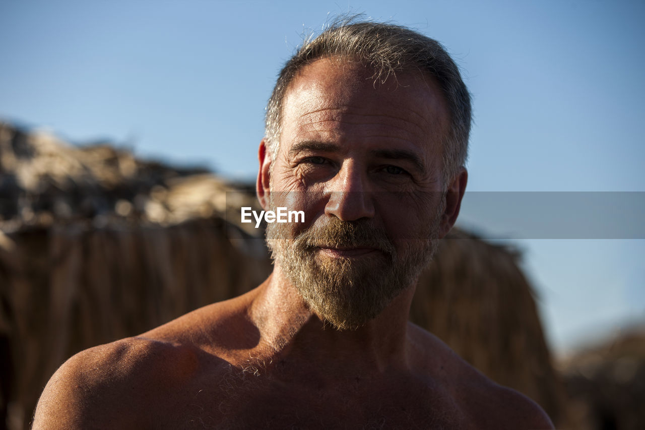 Portrait Of Shirtless Bearded Mature Man