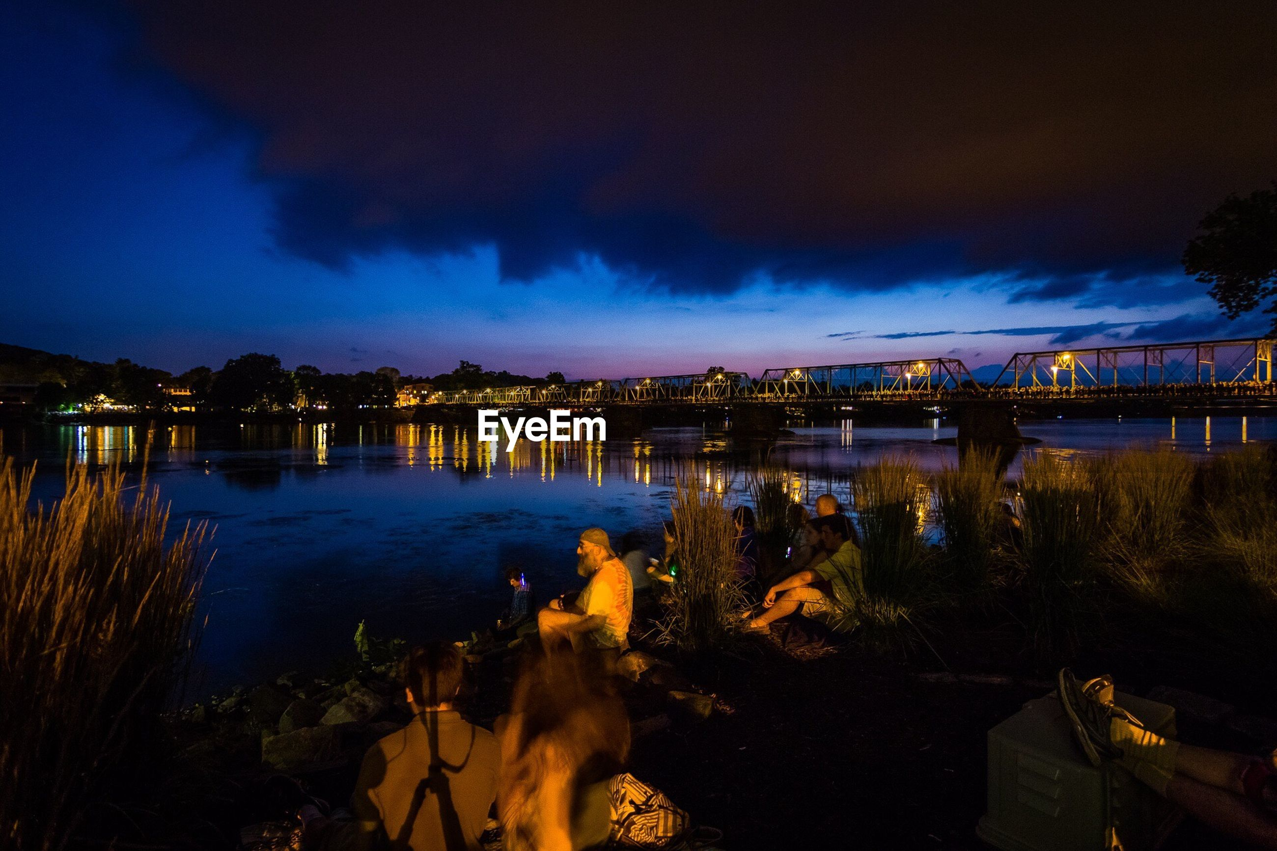 built structure, architecture, sky, water, building exterior, night, illuminated, cloud - sky, outdoors, nature, river, no people, beauty in nature, tree, city