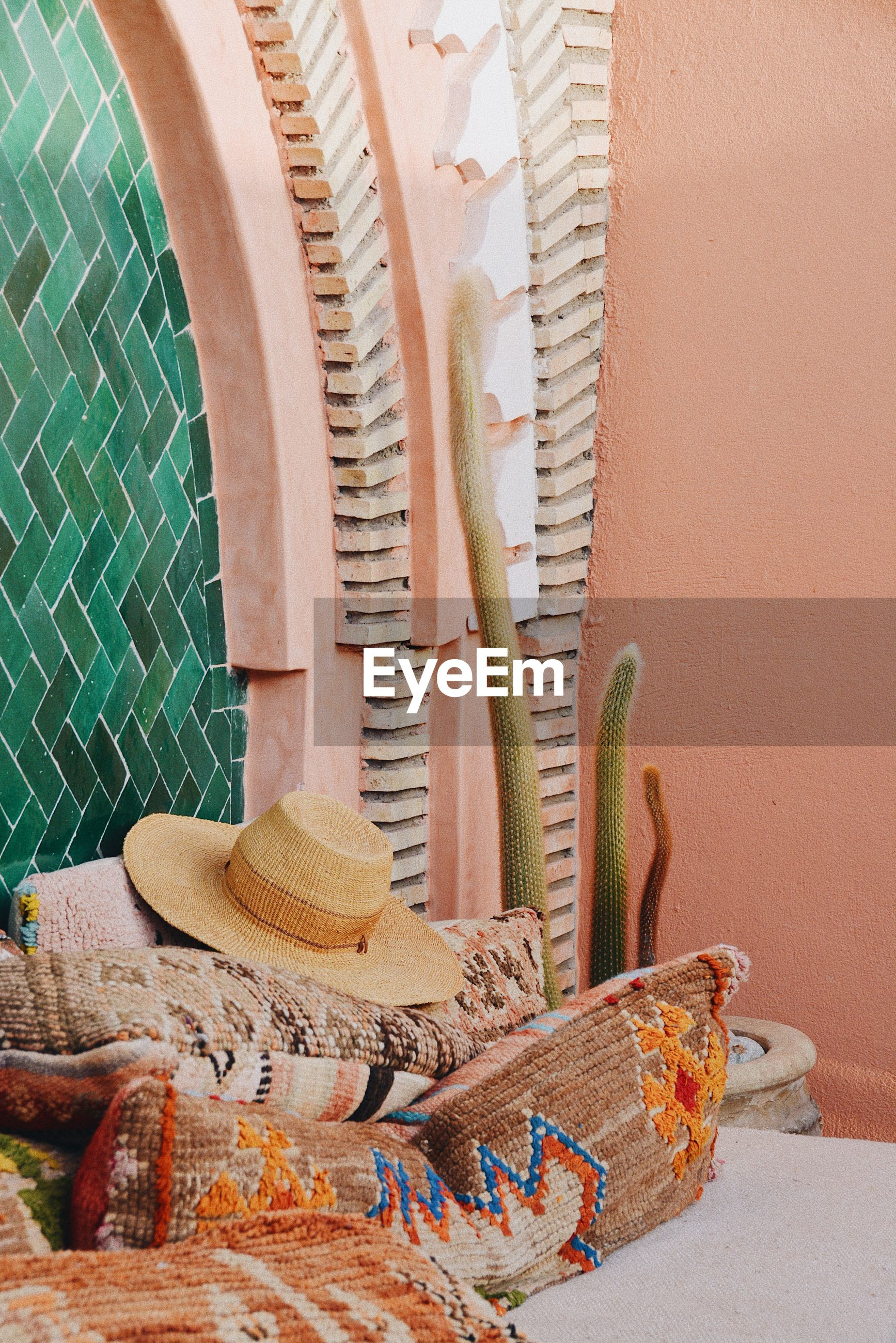 Hat and textile against wall