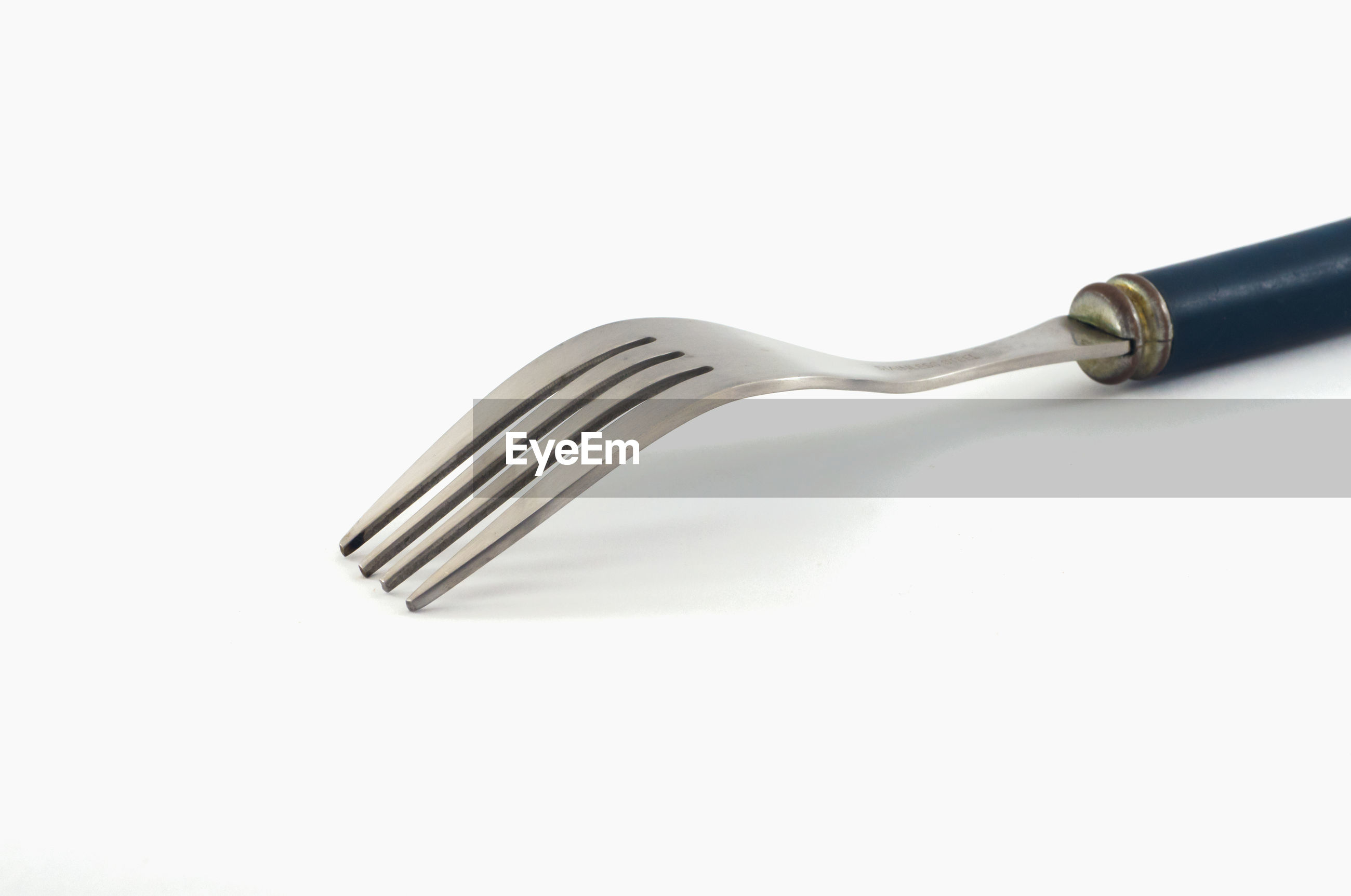 HIGH ANGLE VIEW OF FORK OVER WHITE BACKGROUND