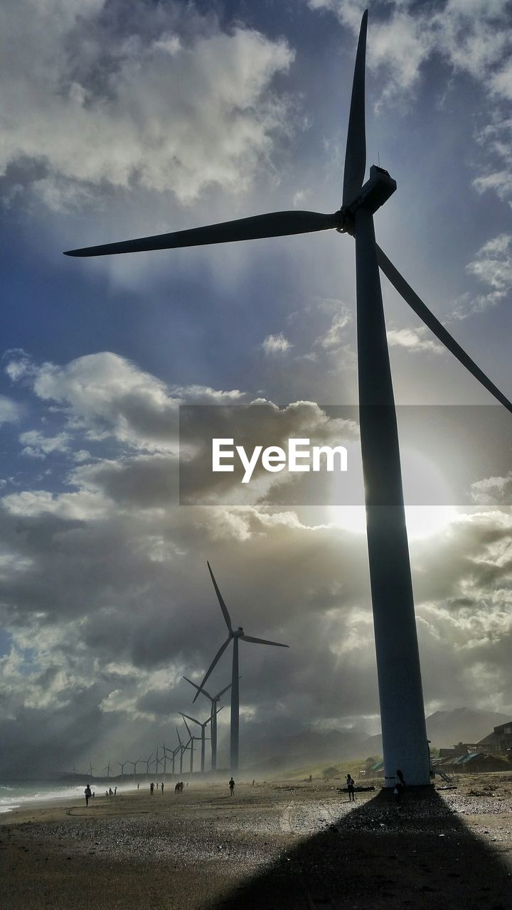 wind power, wind turbine, alternative energy, environmental conservation, renewable energy, fuel and power generation, windmill, cloud - sky, industrial windmill, sky, nature, outdoors, low angle view, day, field, no people, technology, scenics, traditional windmill, rural scene, beauty in nature, landscape, power in nature