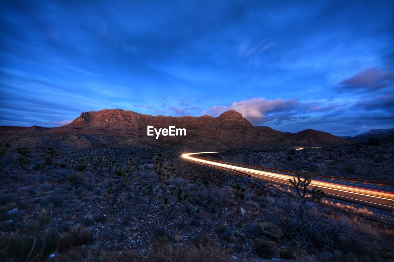 High Angle View Of Light Trails On Mountain Road Against Sky
