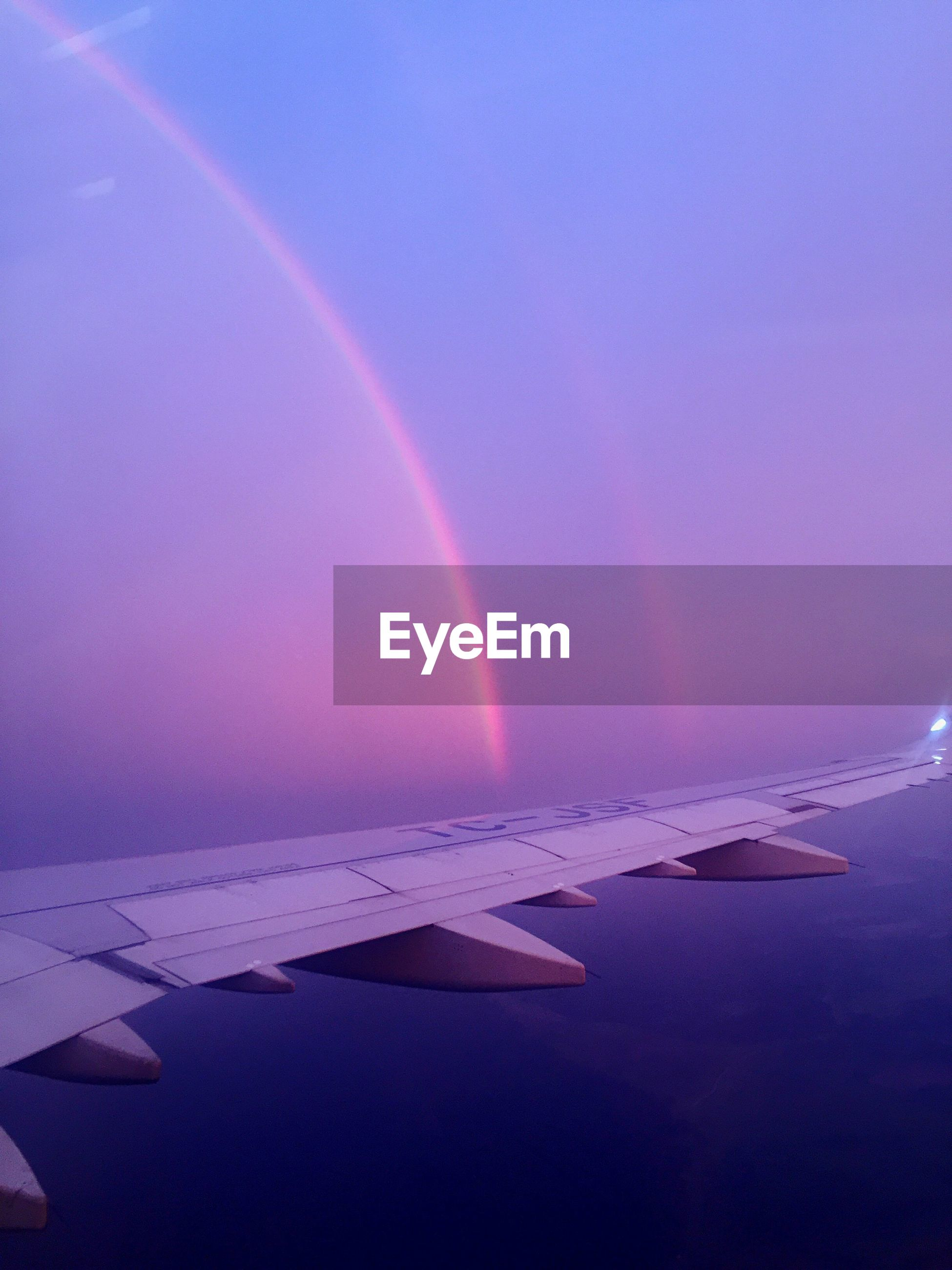 VIEW OF RAINBOW OVER AIRPLANE