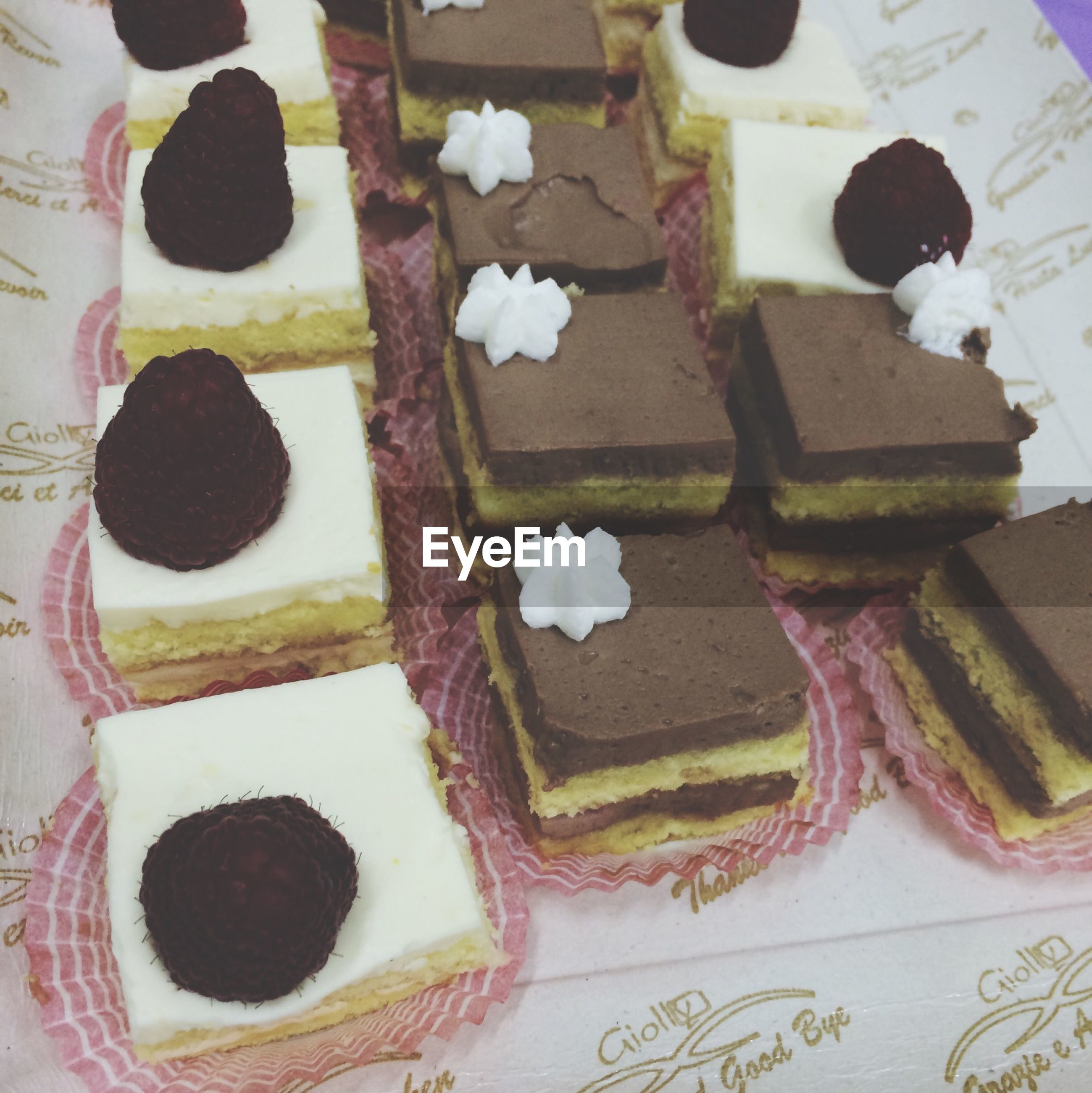 indoors, still life, sweet food, creativity, art and craft, art, high angle view, close-up, table, dessert, unhealthy eating, white color, multi colored, cake, decoration, freshness, variation, no people, indulgence, heart shape