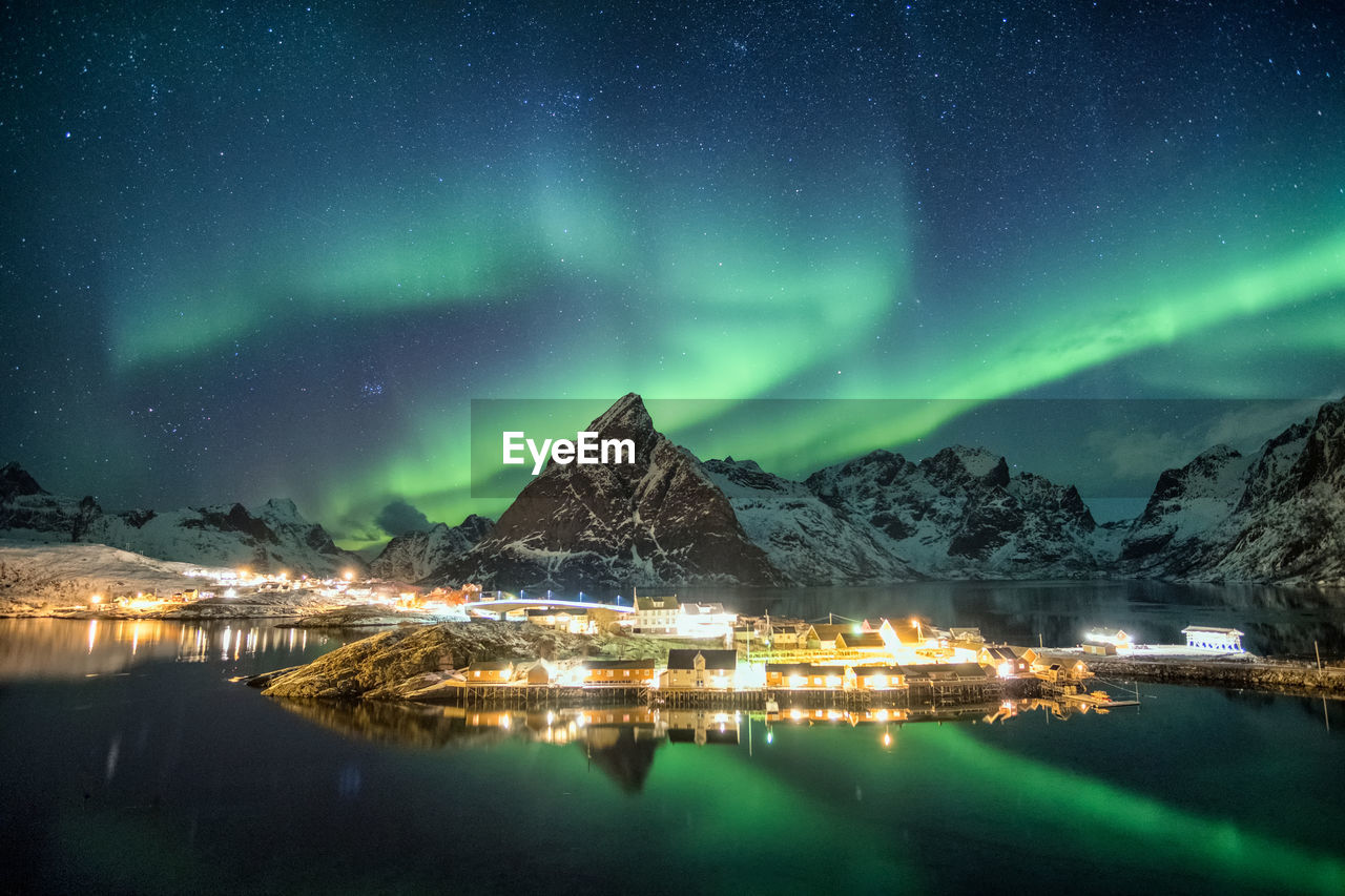 night, sky, illuminated, scenics - nature, mountain, beauty in nature, water, star - space, reflection, mountain range, no people, nature, winter, tranquil scene, cold temperature, waterfront, snow, green color, astronomy, snowcapped mountain, aurora polaris, outdoors, milky way